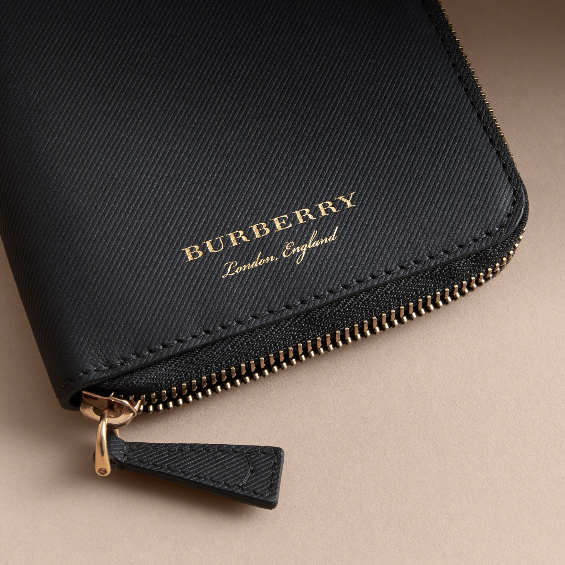 Trench Leather Ziparound Wallet in Black - Men | Burberry - gallery image 1
