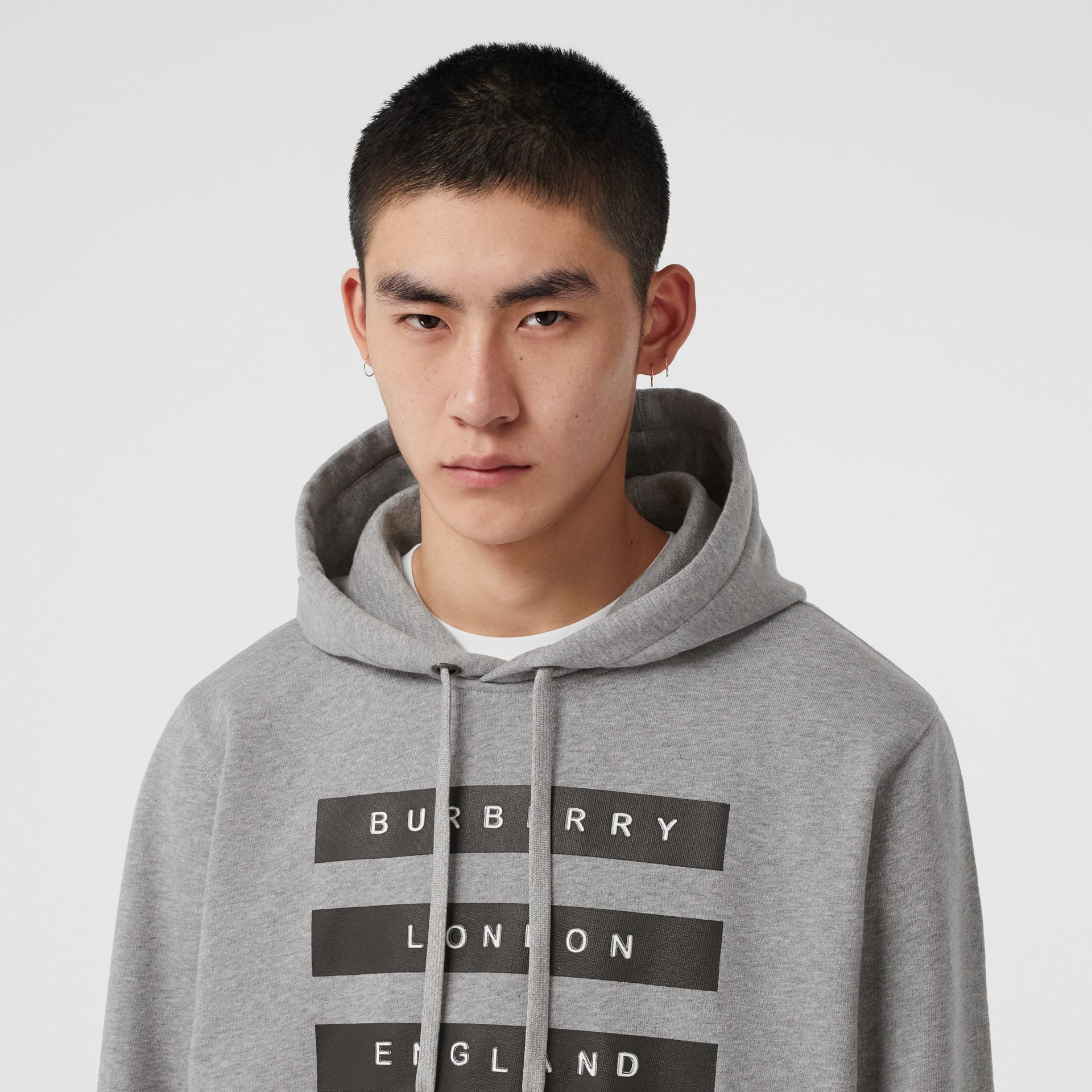 Tape Print Cotton Hoodie in Pale Grey Melange - Men | Burberry United Kingdom - gallery image 1