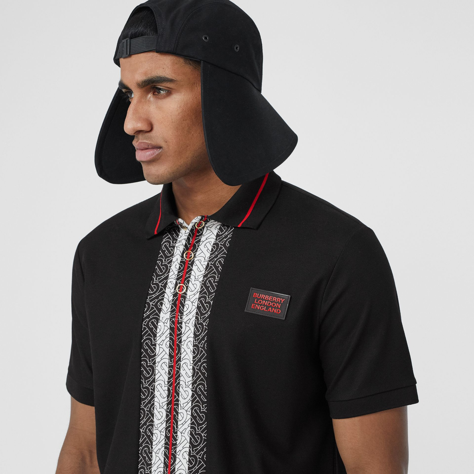 Monogram Stripe Print Cotton Piqué Polo Shirt in Black - Men | Burberry - gallery image 1