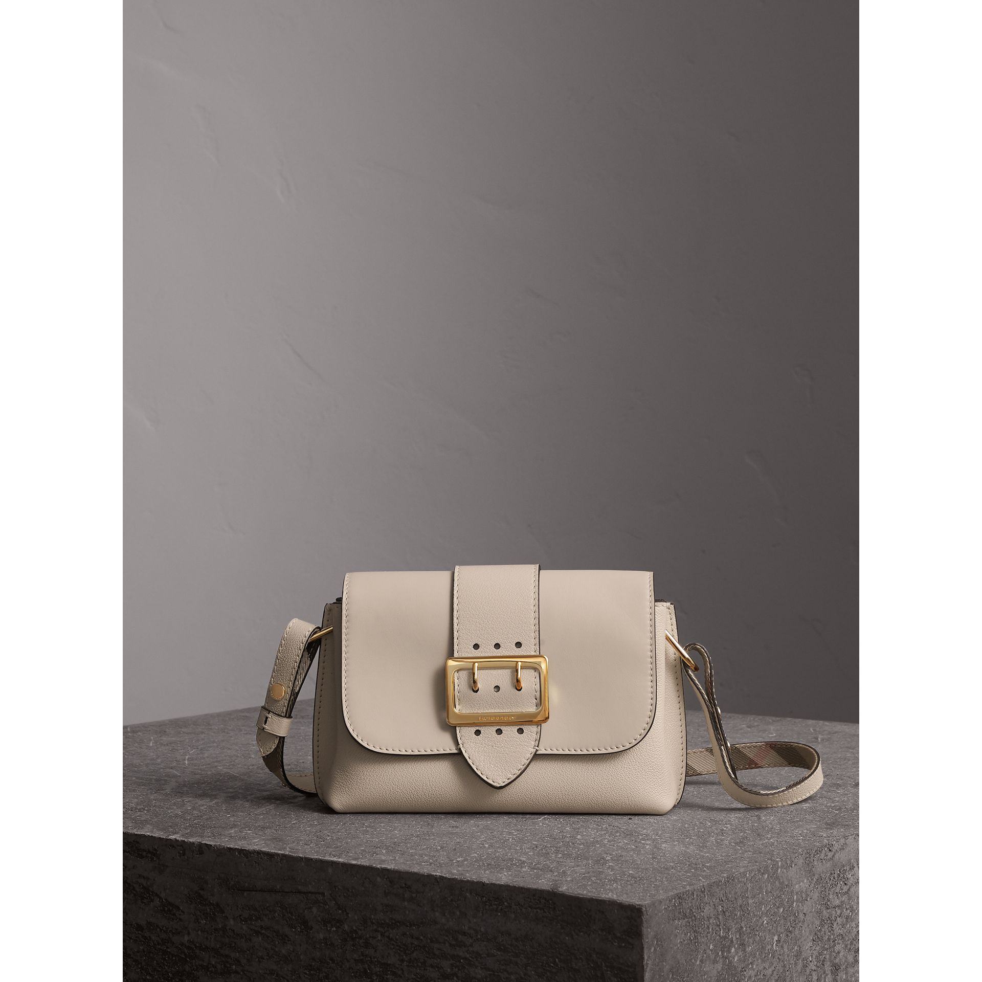 The Buckle Crossbody Bag in Leather in Limestone - Women | Burberry United Kingdom - gallery image 1
