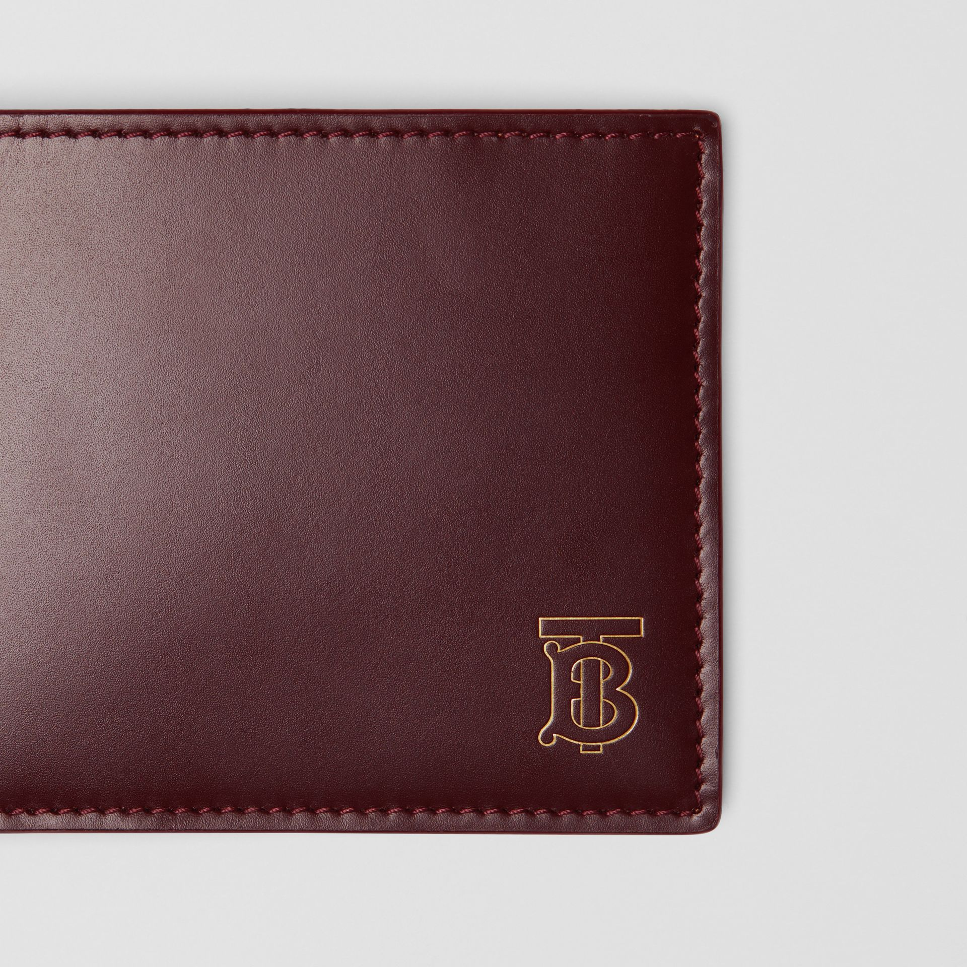Monogram Motif Leather International Bifold Wallet in Oxblood - Men | Burberry Australia - gallery image 1