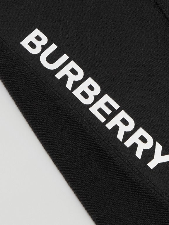Logo Graphic Cotton Trackpants in Black | Burberry - cell image 1