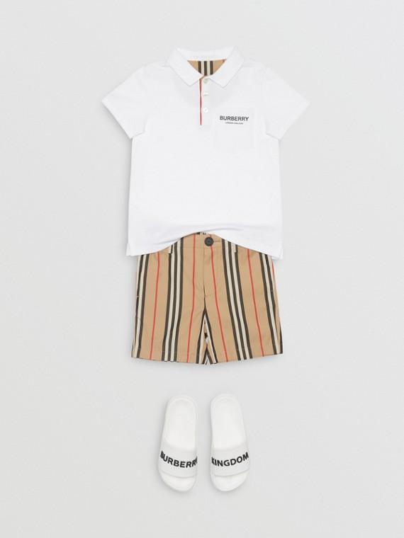 Polo en piqué de coton avec patte de boutonnage à rayures iconiques (Blanc)