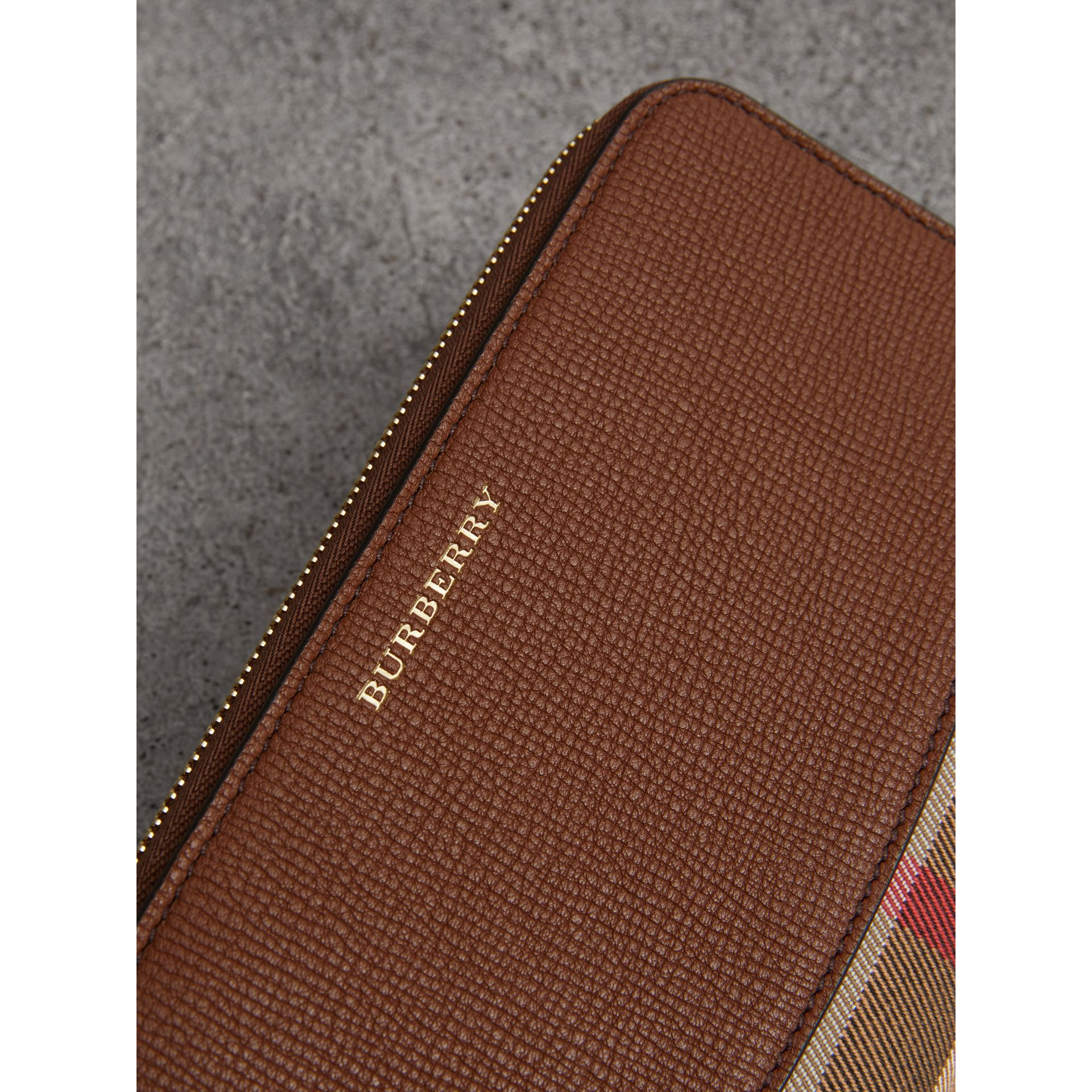 House Check and Leather Ziparound Wallet in Brown Ochre - Women | Burberry Canada - gallery image 1