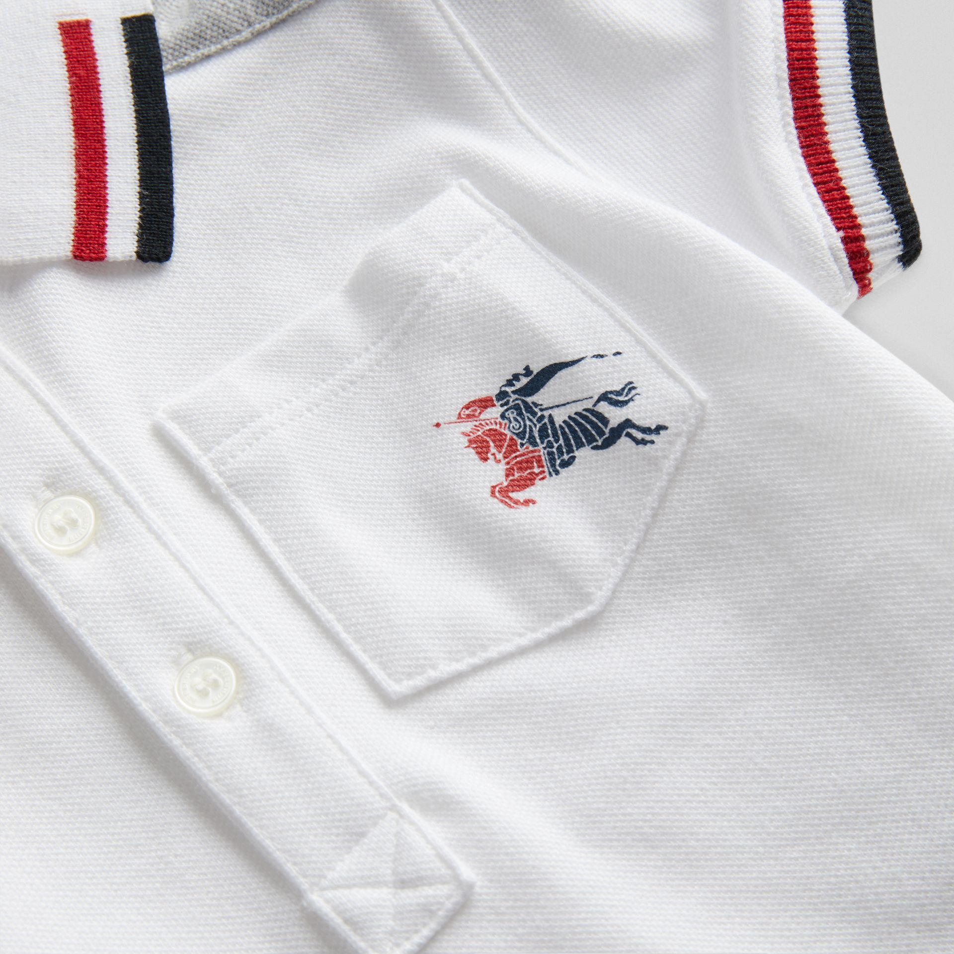 Stripe Detail Cotton Piqué Polo Shirt in White - Children | Burberry - gallery image 1