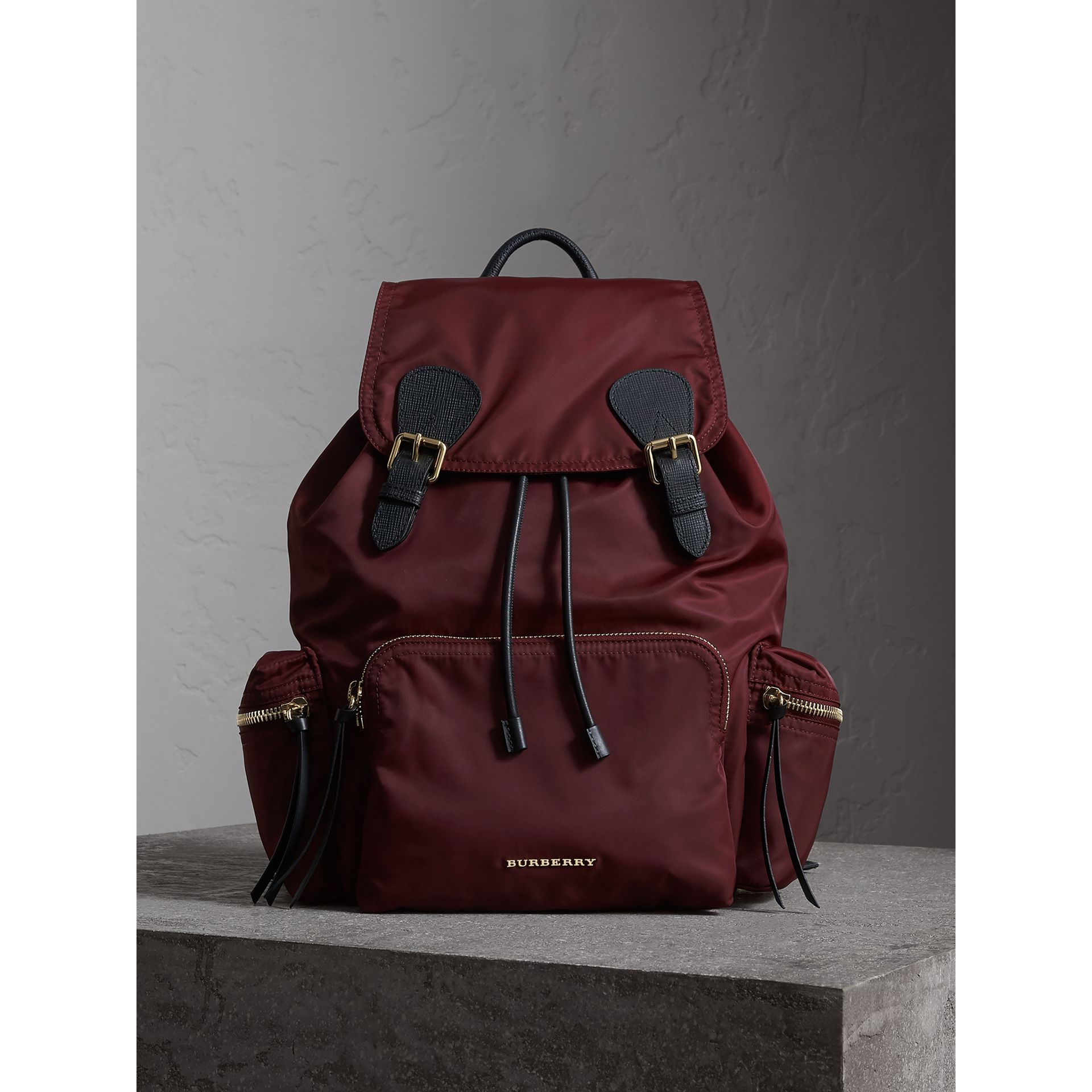 The Large Rucksack in Technical Nylon and Leather in Burgundy Red - gallery image 1