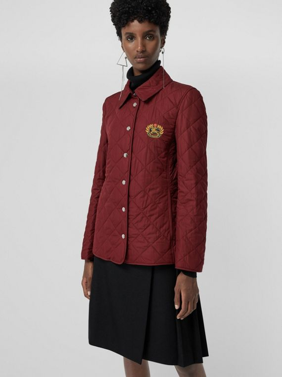 Embroidered Crest Diamond Quilted Jacket in Damson