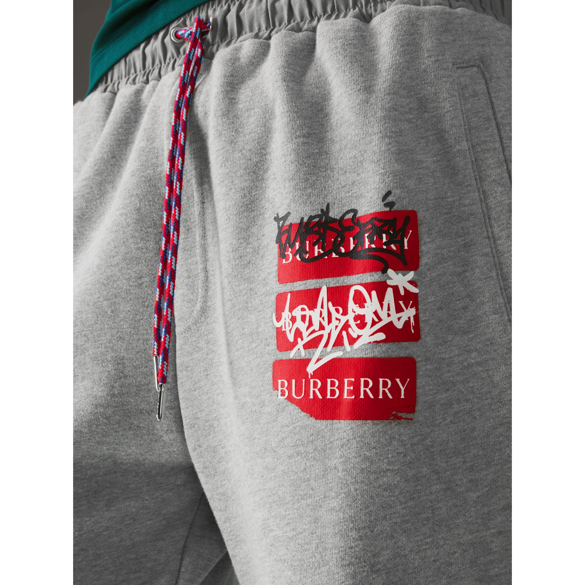 Graffitied Ticket Print Sweatpants in Pale Grey Melange - Men | Burberry United Kingdom - gallery image 1