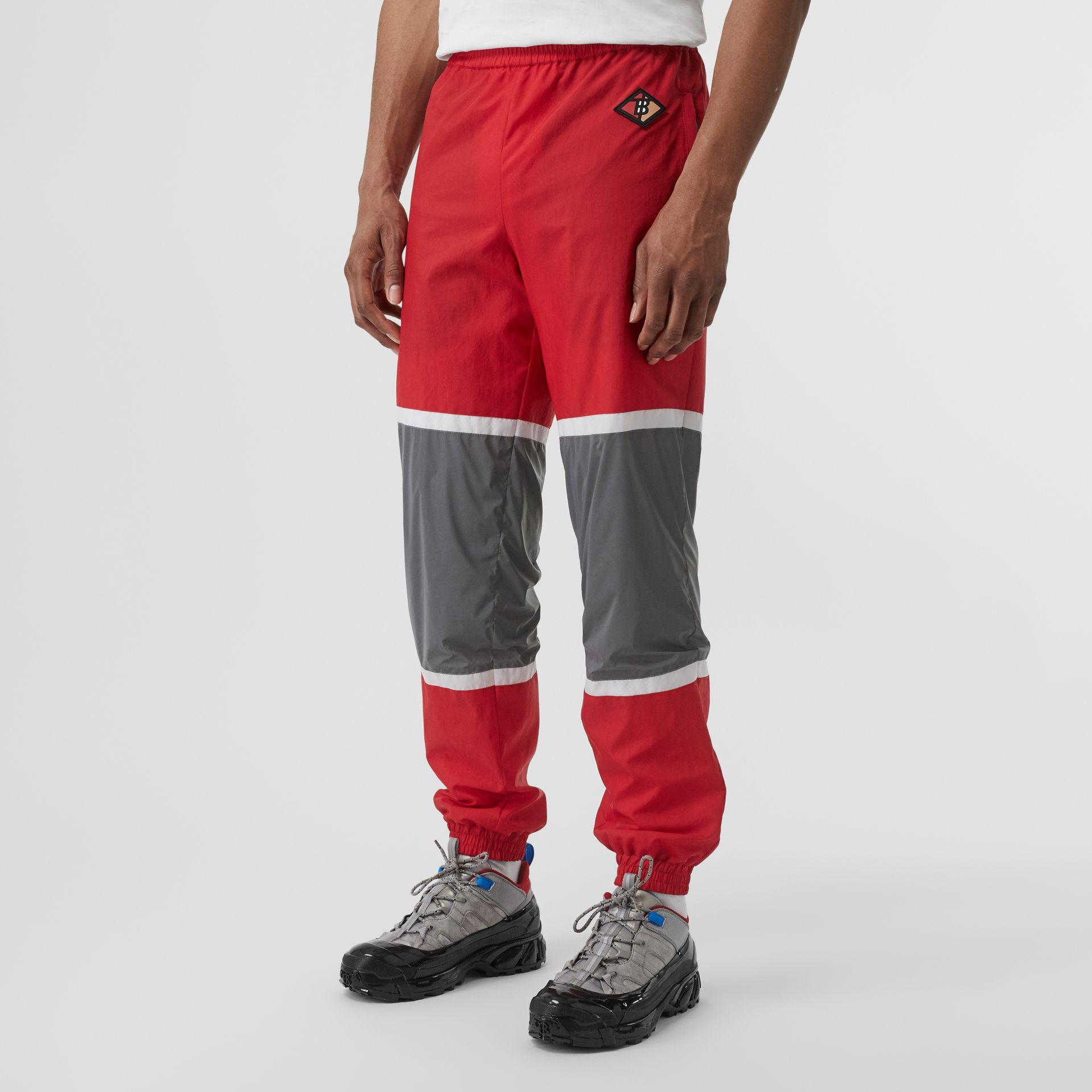 Logo Graphic Striped Nylon Trackpants in Bright Red - Men | Burberry - gallery image 4