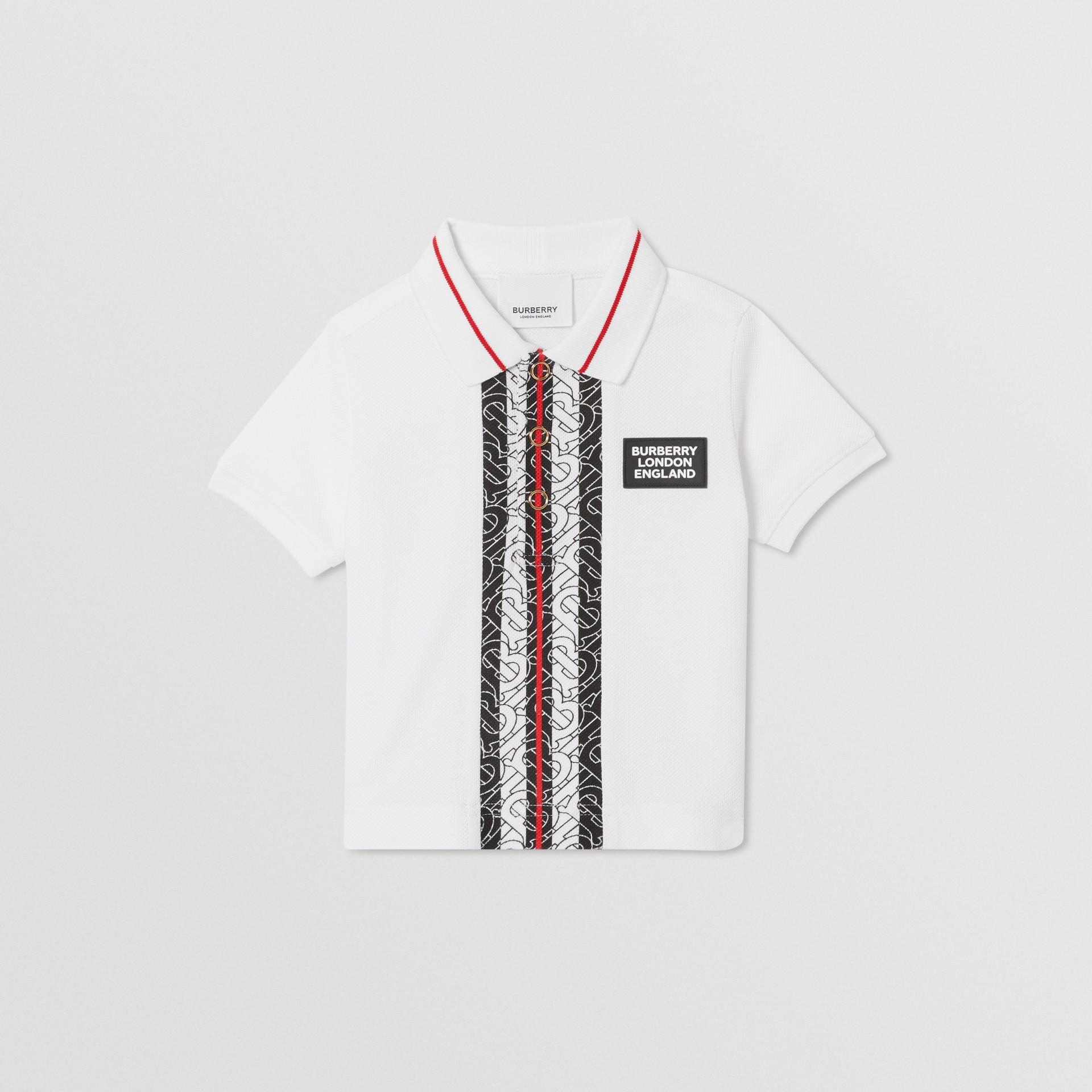 Monogram Stripe Cotton Piqué Polo Shirt in White - Children   Burberry - gallery image 0