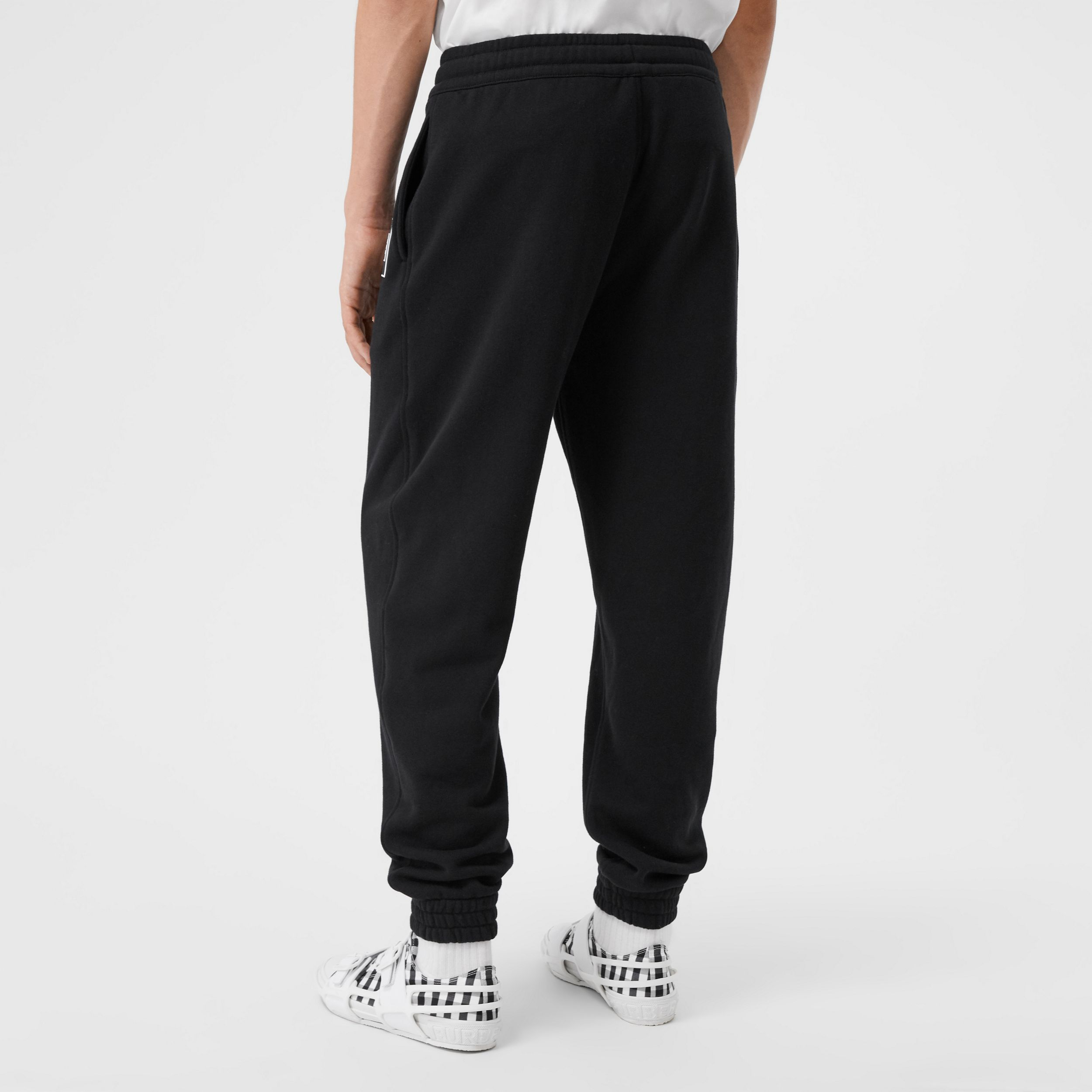 Logo Appliqué Cotton Jogging Pants in Black - Men | Burberry - 3