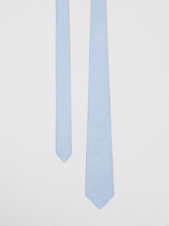 Corbata de pala clásica en seda con monogramas en jacquard (Azul Pálido)