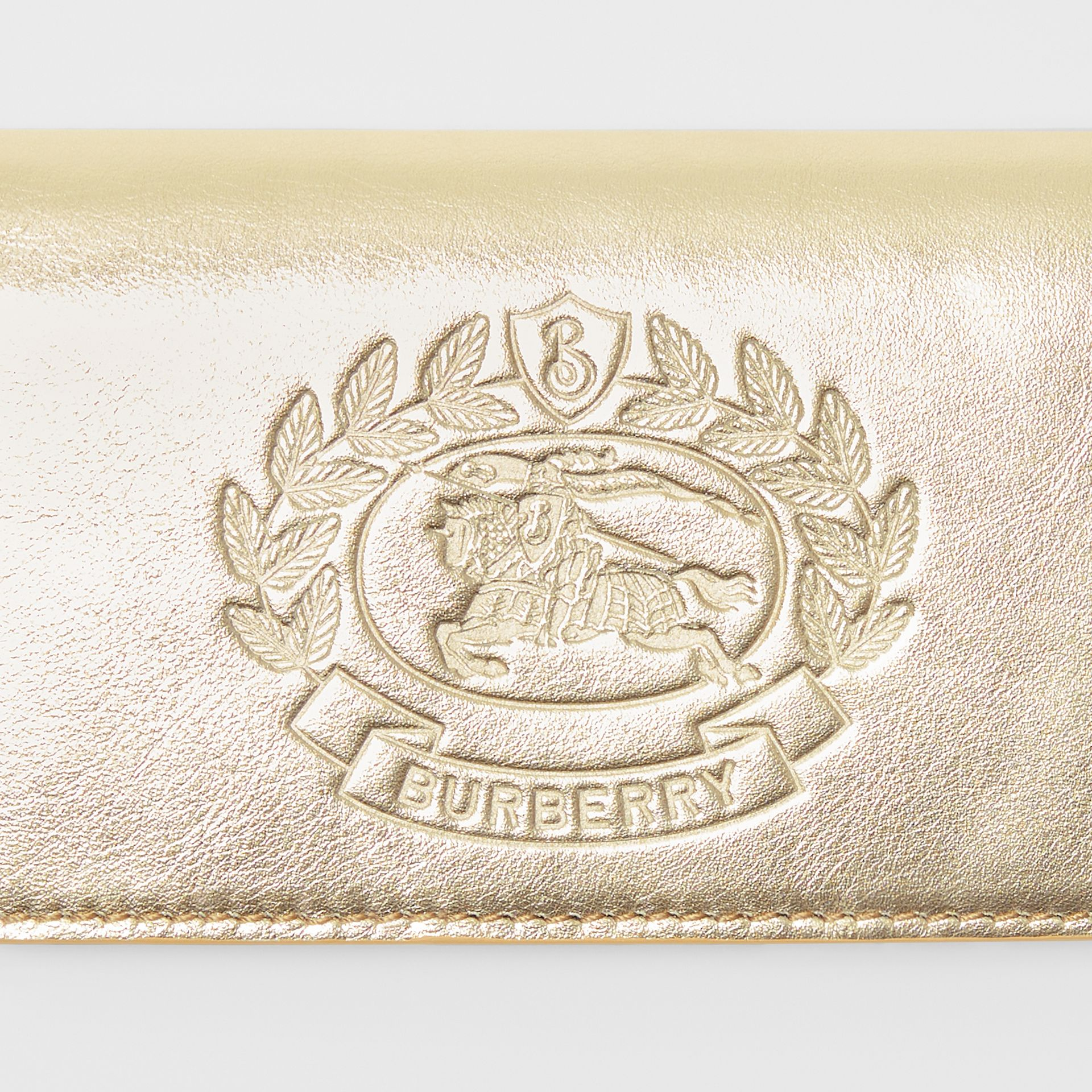 Small Embossed Crest Metallic Leather Wallet in Gold - Women | Burberry United Kingdom - gallery image 1