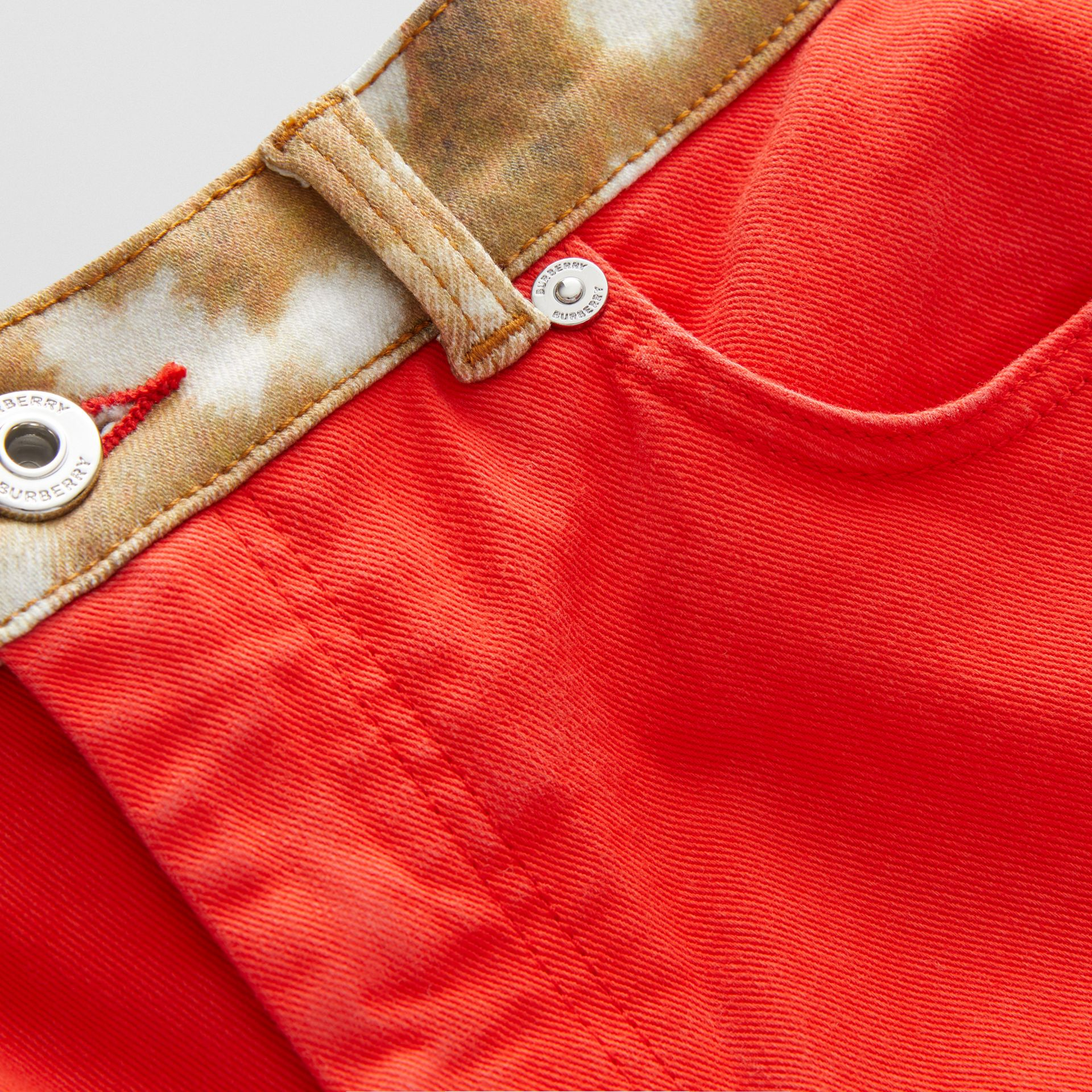 Flared Fit Deer Print Trim Japanese Denim Jeans in Bright Red | Burberry - gallery image 1