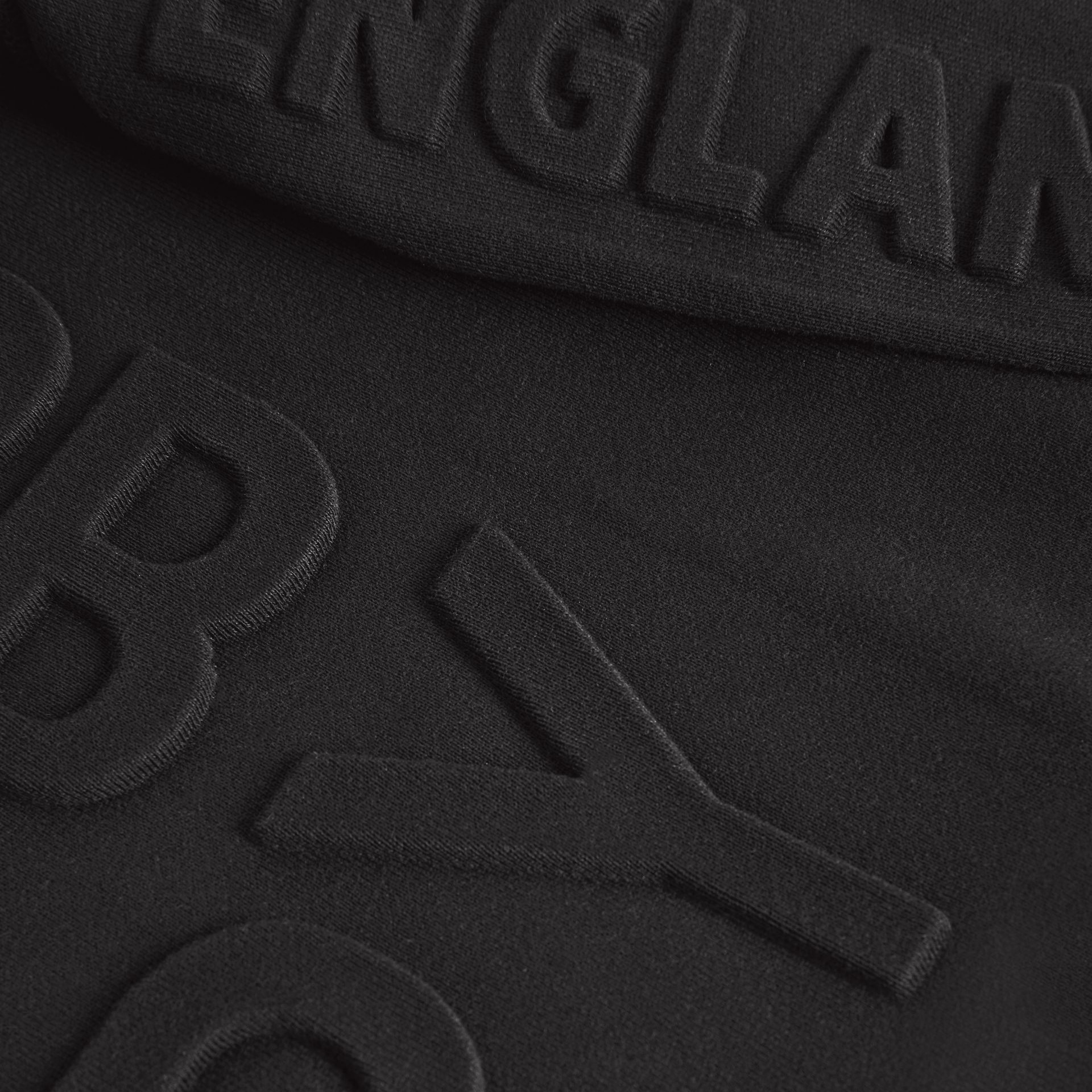 Embossed Logo Cotton Sweatshirt in Black | Burberry - gallery image 1