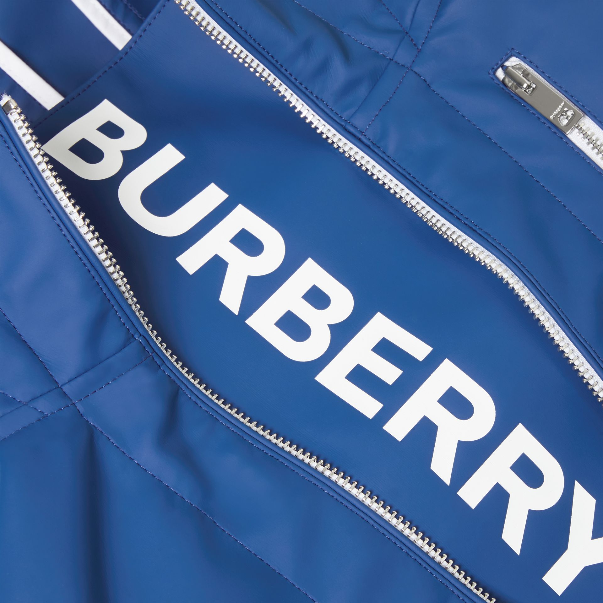 Logo Print Showerproof Hooded Jacket in Imperial Blue | Burberry - gallery image 1