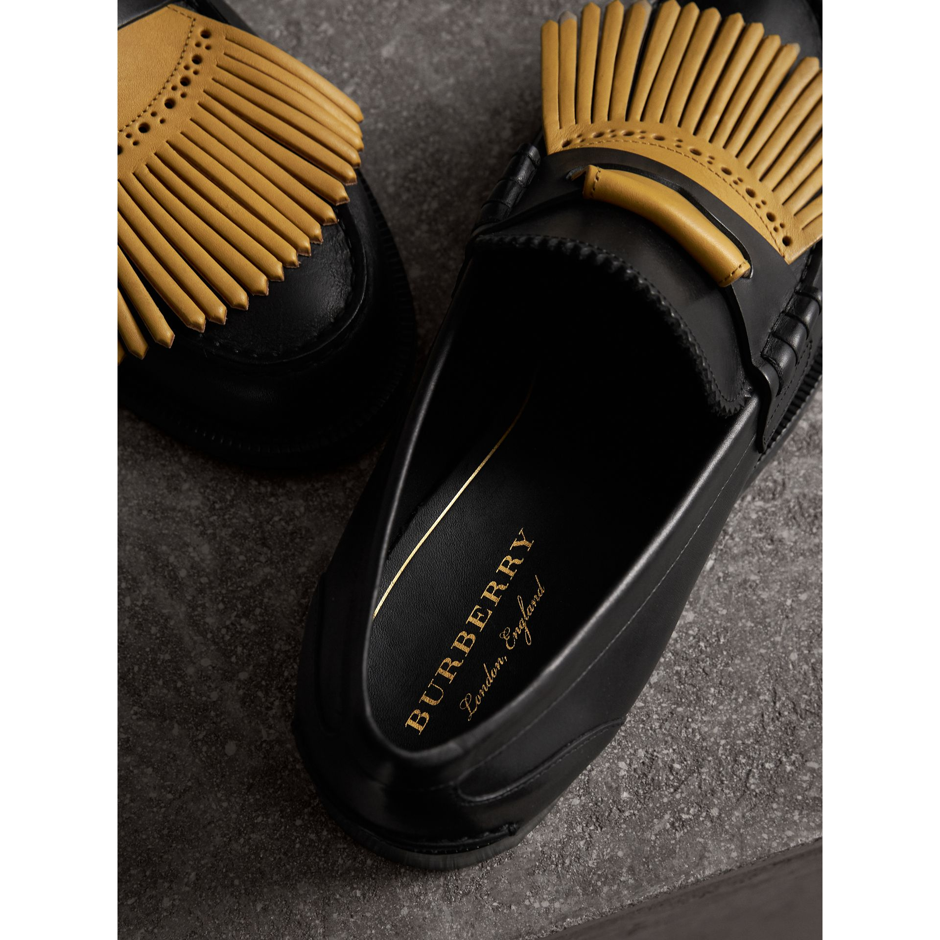 Contrast Kiltie Fringe Leather Loafers in Black/pale Saffron Yellow - Men | Burberry - gallery image 1