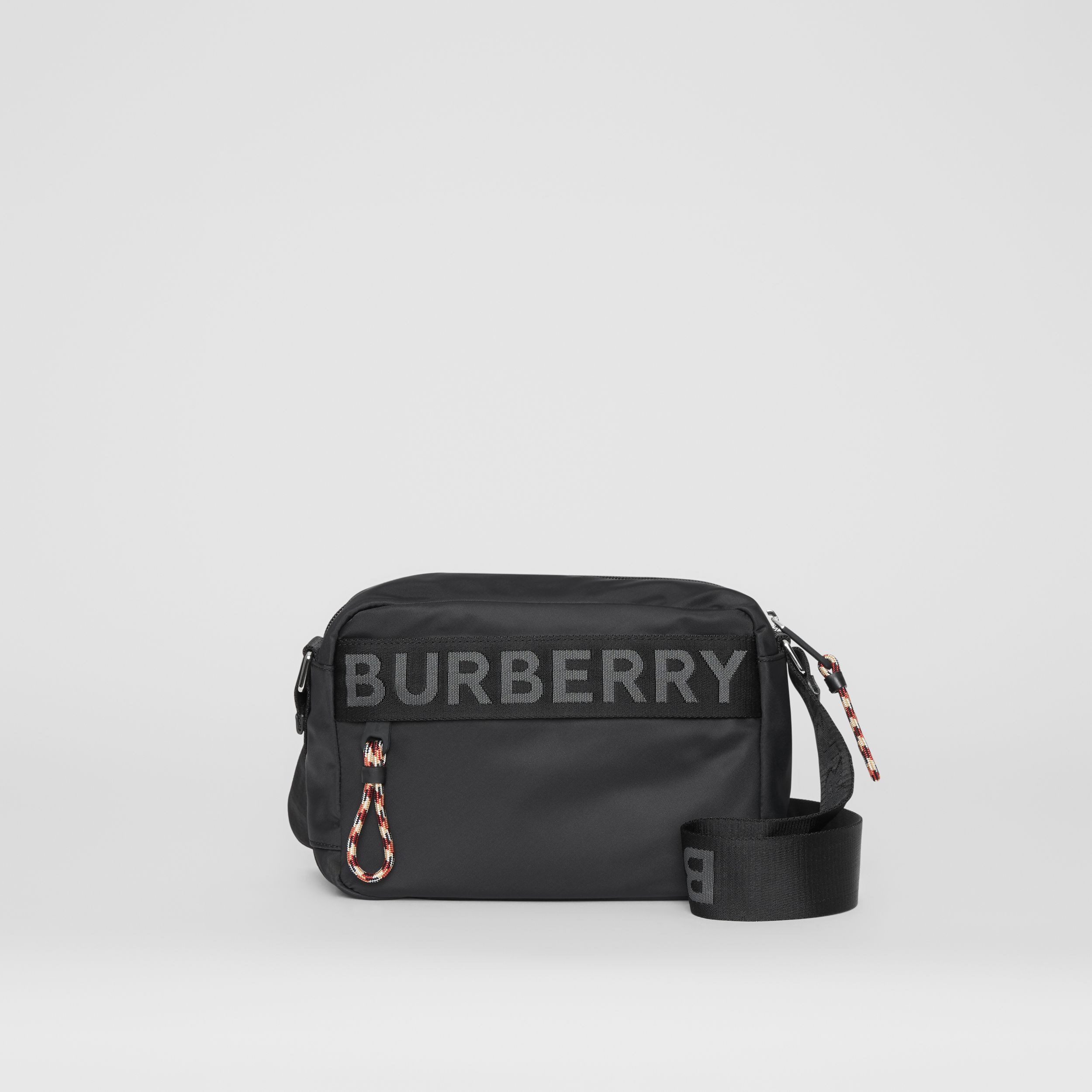 Logo Detail ECONYL® Crossbody Bag in Black - Men | Burberry - 1