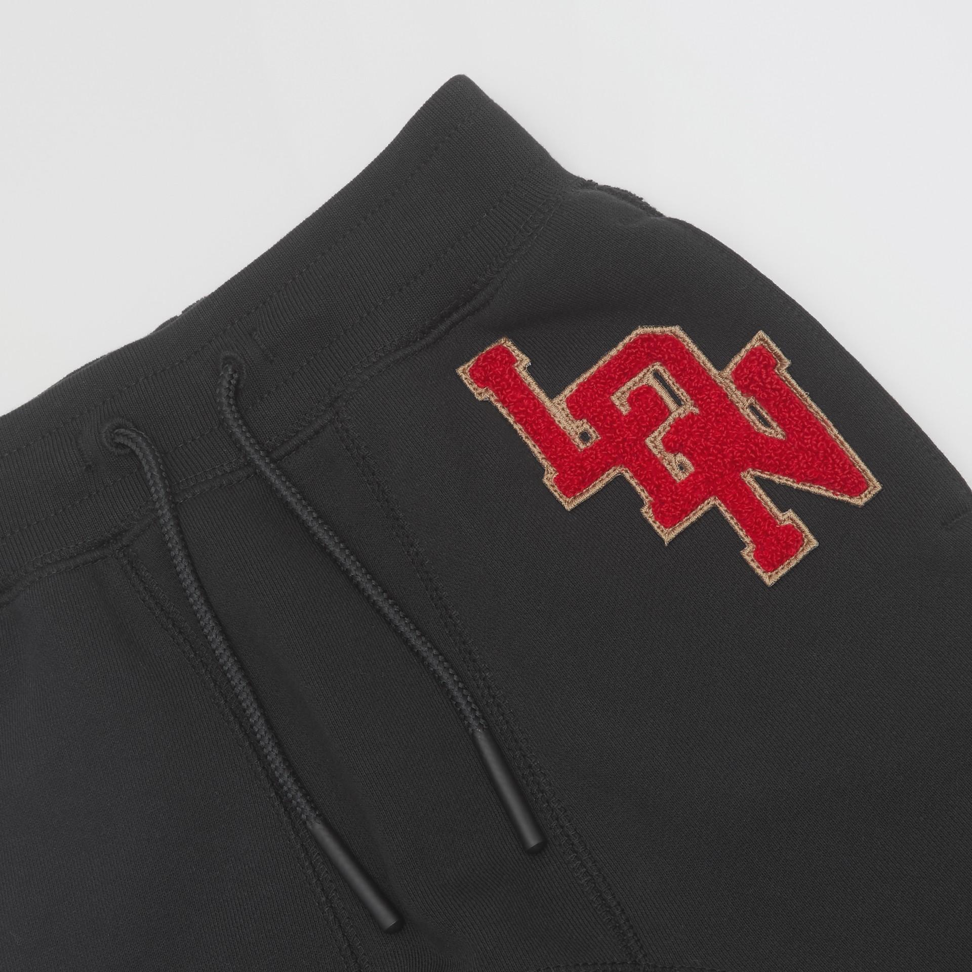 Pantalon de survêtement en coton à logo (Noir) - Enfant | Burberry - photo de la galerie 1