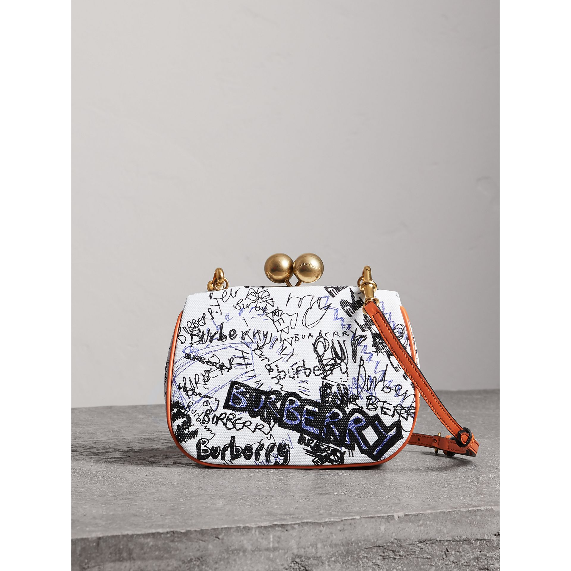 Small Doodle Print Metal Frame Clutch Bag in White/orange Saffron - Women | Burberry - gallery image 0