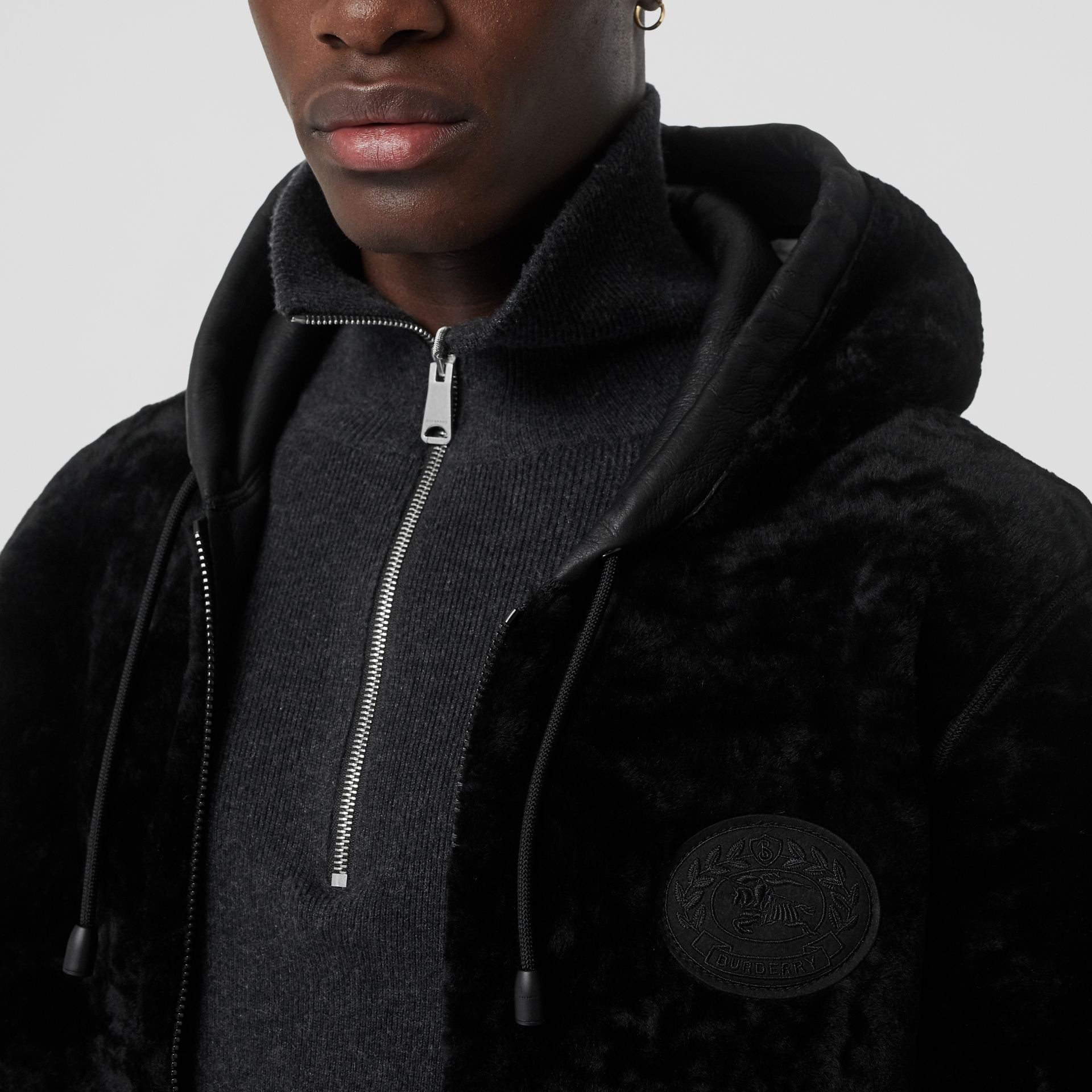 Reversible Shearling Hooded Bomber Jacket in Black - Men | Burberry - gallery image 1