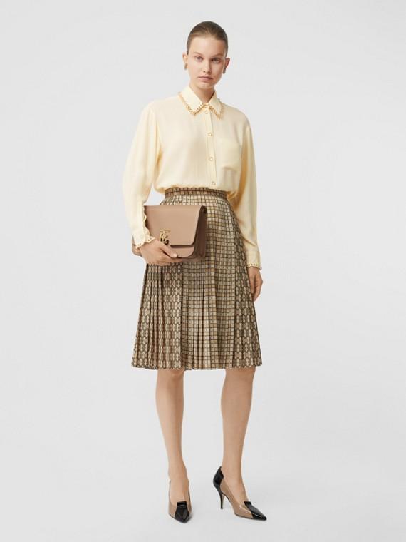Oversize-Bluse aus Seide mit Piercingdetails (Vanille)