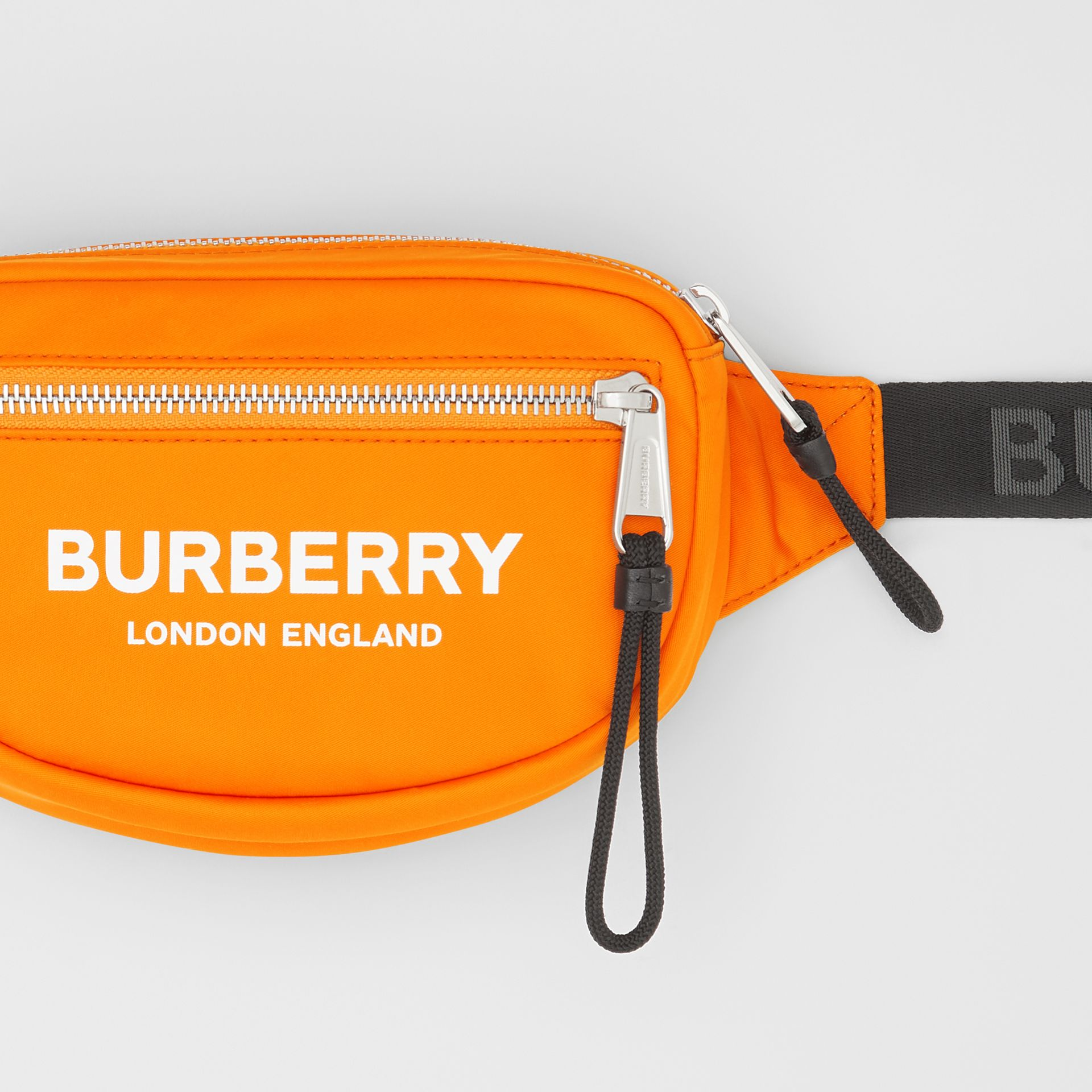 Small Logo Print ECONYL® Cannon Bum Bag in Bright Orange | Burberry - gallery image 1