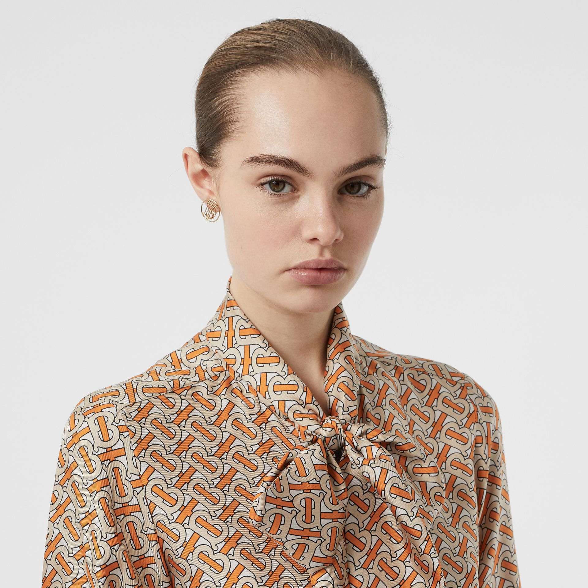 Monogram Print Silk Pussy-bow Blouse in Bright Orange - Women | Burberry United Kingdom - gallery image 1