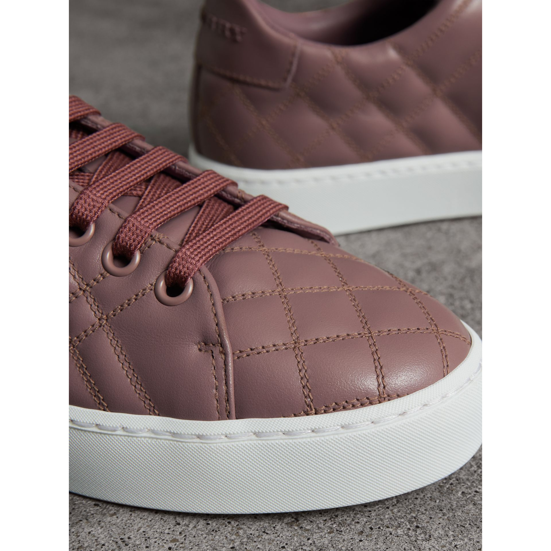 Check-quilted Leather Trainers in Ivory Pink - Women | Burberry United Kingdom - gallery image 2