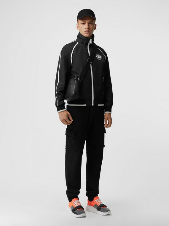 Crest Detail Funnel Neck Track Top in Black