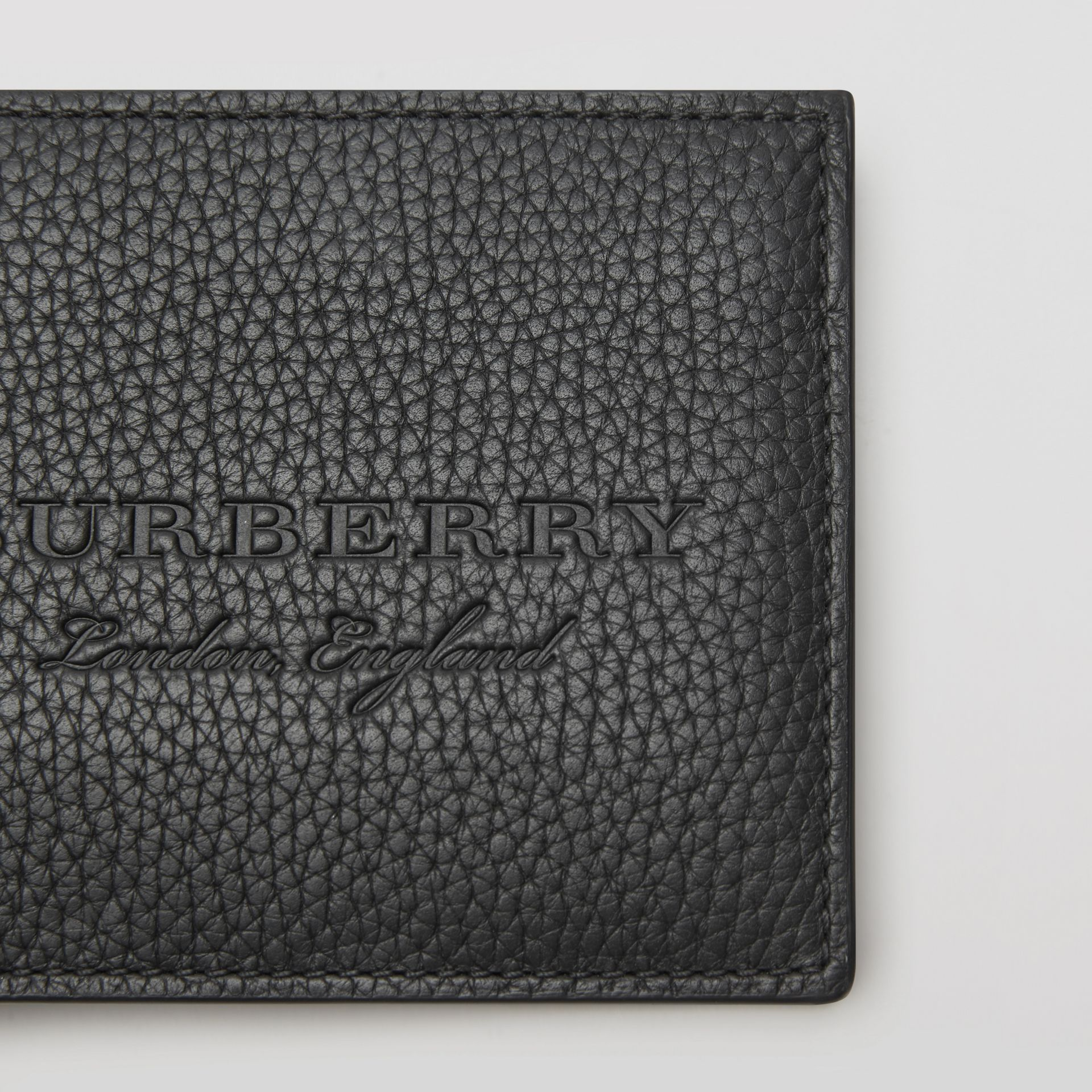Embossed Leather Bifold Wallet in Black - Men | Burberry Hong Kong - gallery image 1