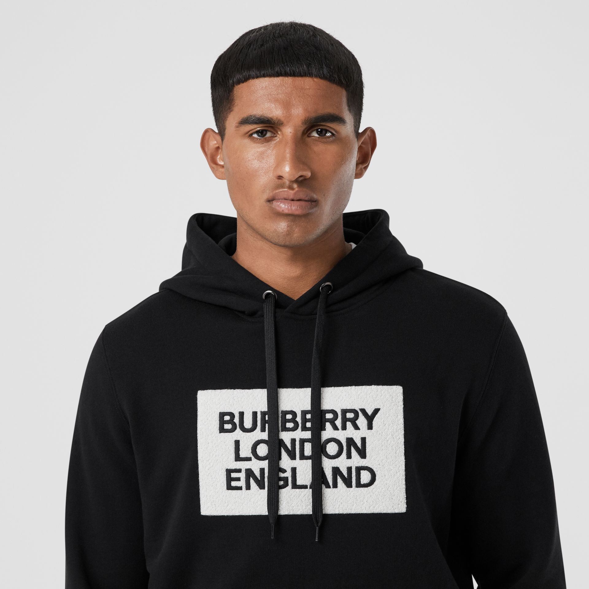 Logo Appliqué Cotton Hoodie in Black - Men | Burberry - gallery image 1