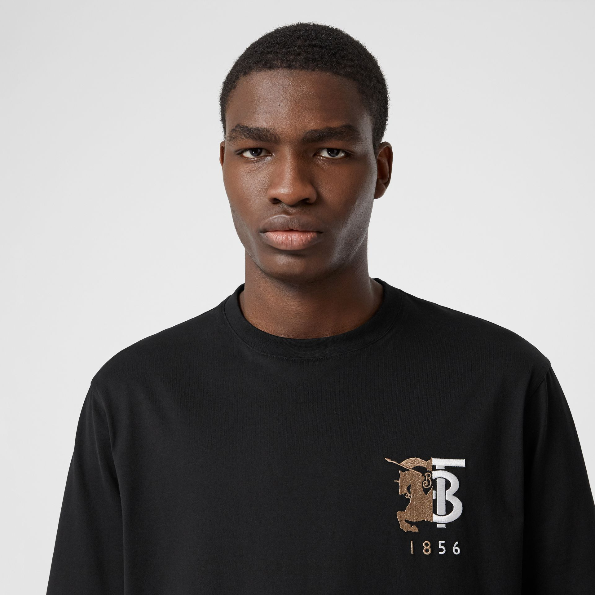 Contrast Logo Graphic Cotton T-shirt in Black - Men | Burberry - gallery image 1