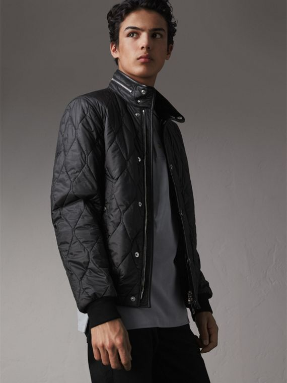 Stand-collar Military-quilted Jacket with Packaway Hood in Black