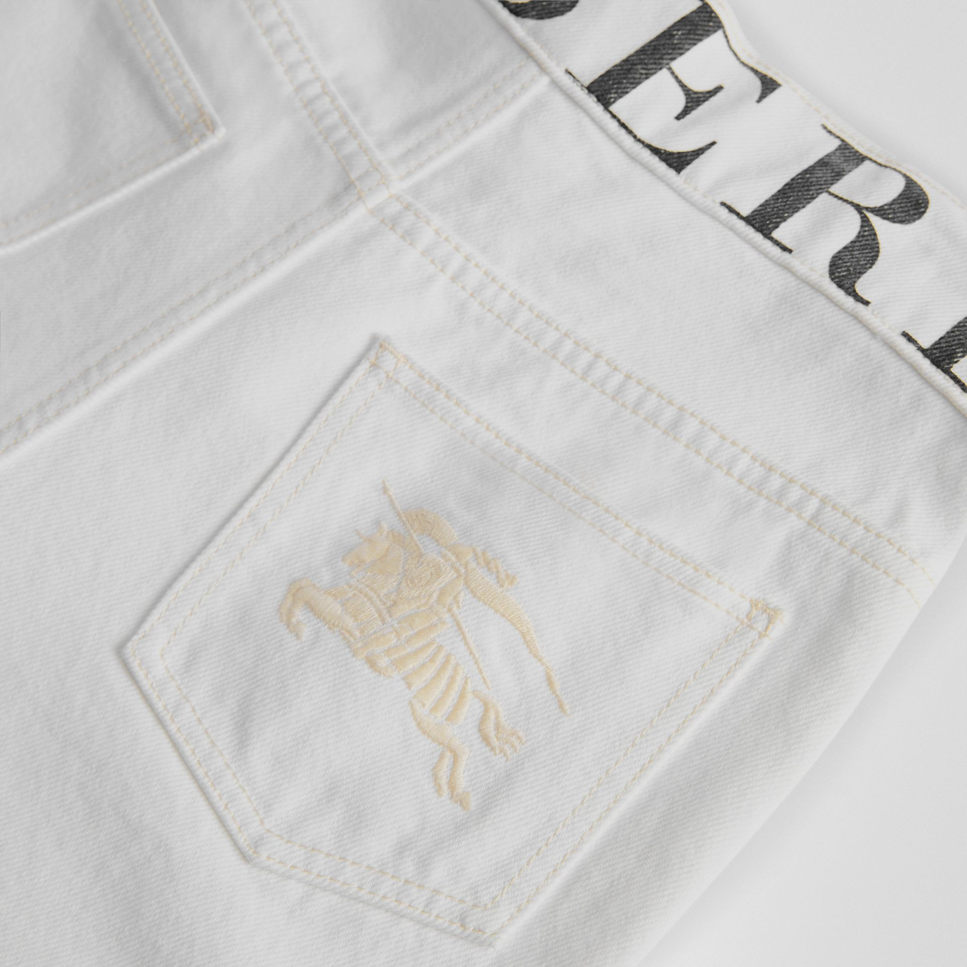 Relaxed Fit Logo Print Jeans in Natural White - Children | Burberry - gallery image 1