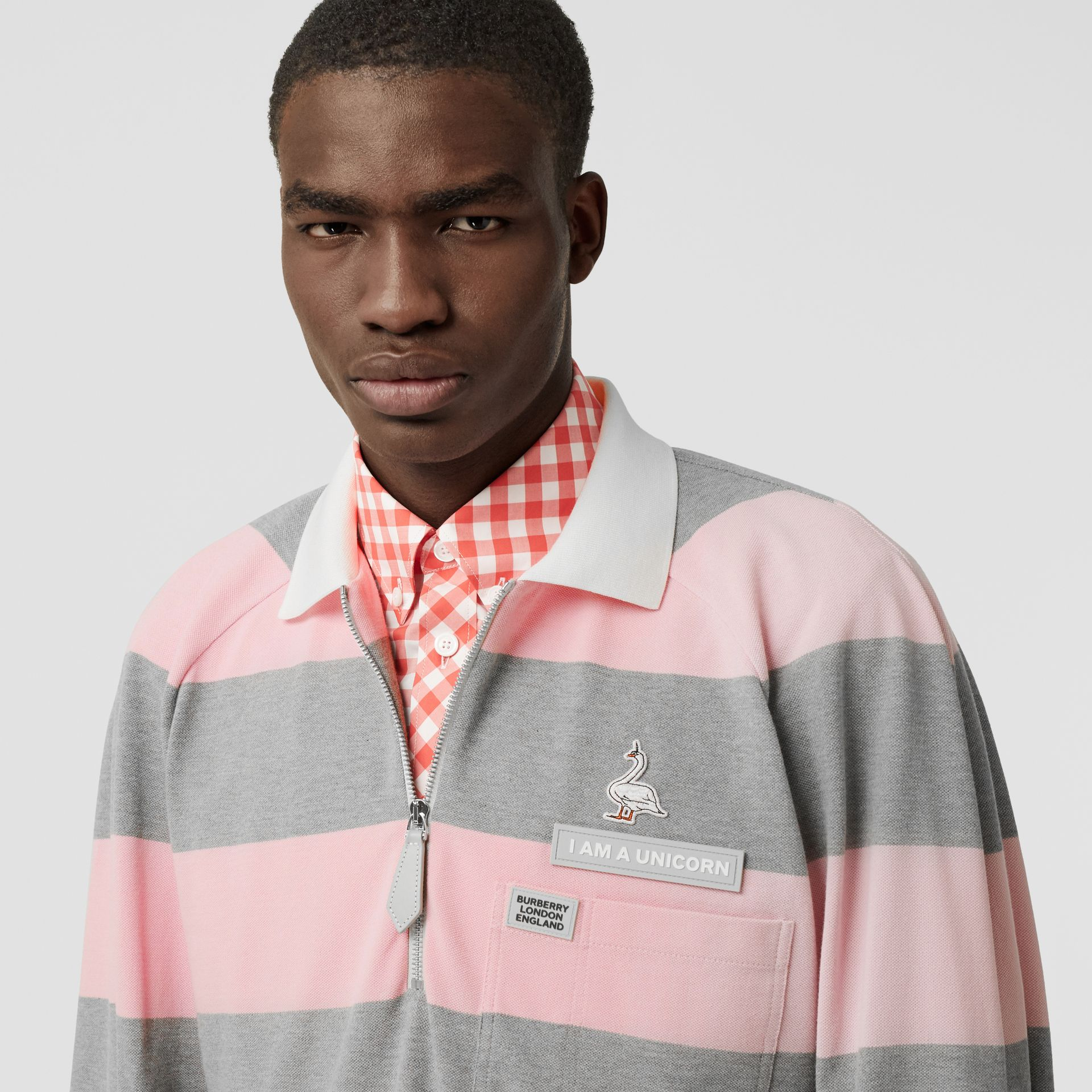 Long-sleeve Zip Detail Striped Cotton Polo Shirt in Pale Pink | Burberry - gallery image 1