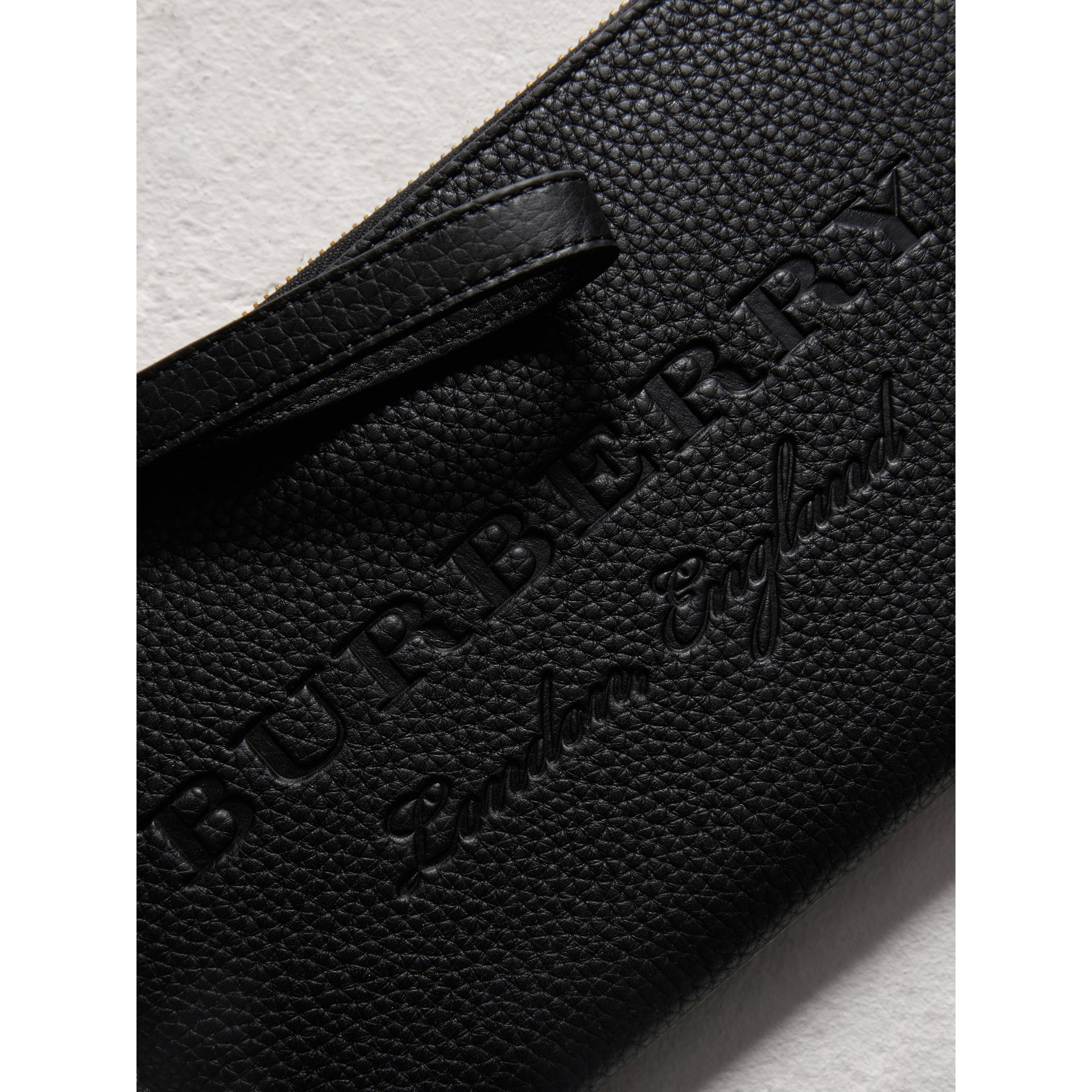 Embossed Leather Travel Wallet in Black | Burberry Australia - gallery image 1