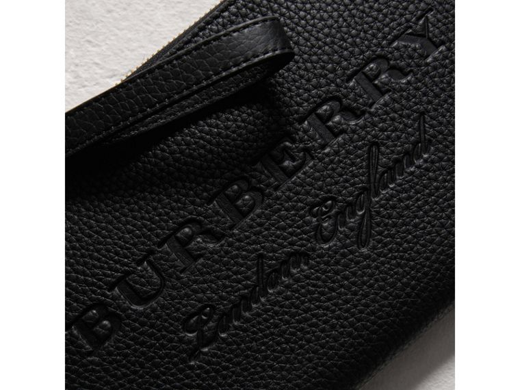 Embossed Leather Travel Wallet in Black | Burberry Australia - cell image 1