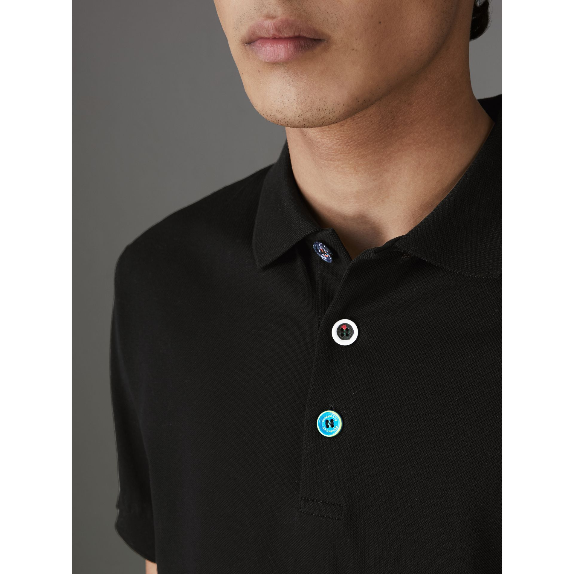 Painted Button Cotton Piqué Polo Shirt in Black - Men | Burberry - gallery image 1