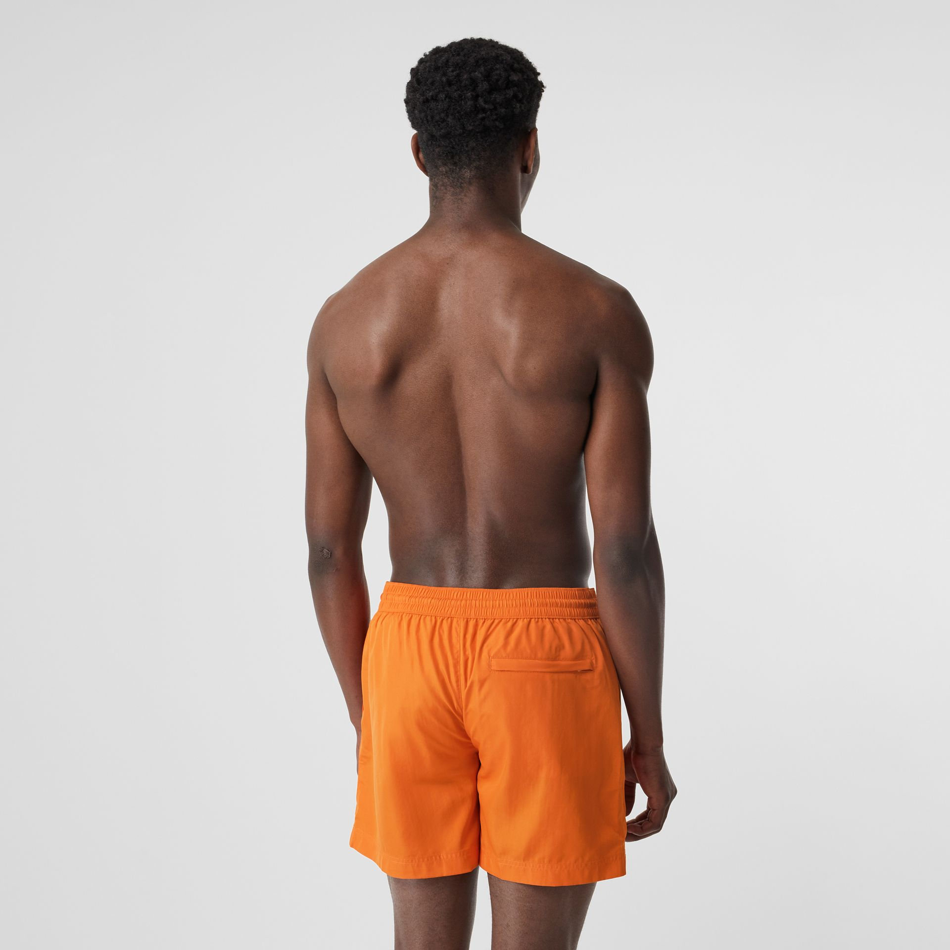 Logo Detail Drawcord Swim Shorts in Bright Orange - Men | Burberry Canada - gallery image 1