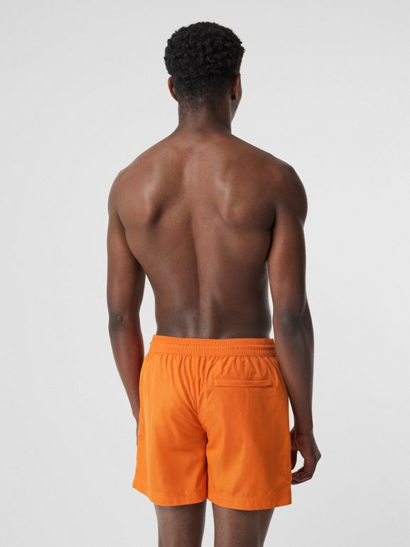 Logo Detail Drawcord Swim Shorts in Bright Orange - Men | Burberry Canada - cell image 1