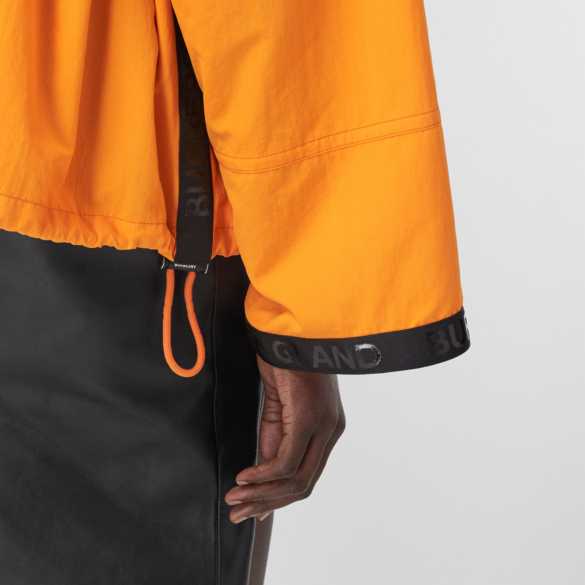 Logo Tape Technical Nylon Hooded Jacket in Bright Orange | Burberry United Kingdom - gallery image 3