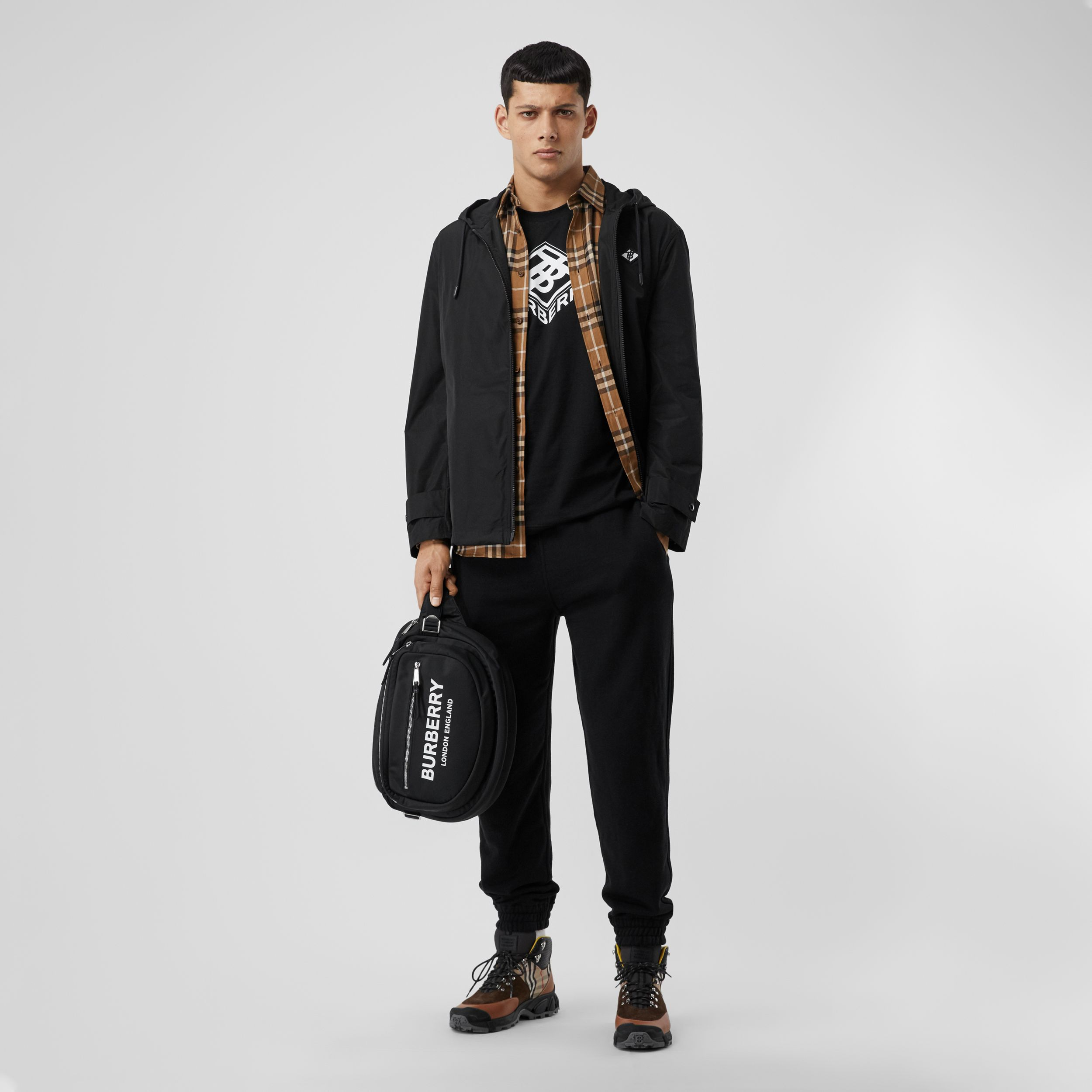 Logo Graphic Shape-memory Taffeta Hooded Jacket in Black - Men | Burberry Canada - 1