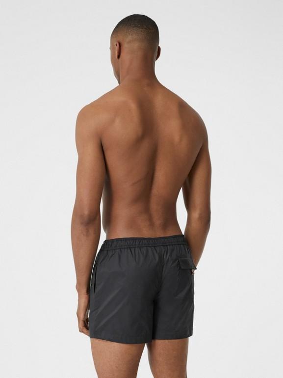 Logo Appliqué Drawcord Swim Shorts in Black - Men | Burberry Australia - cell image 1