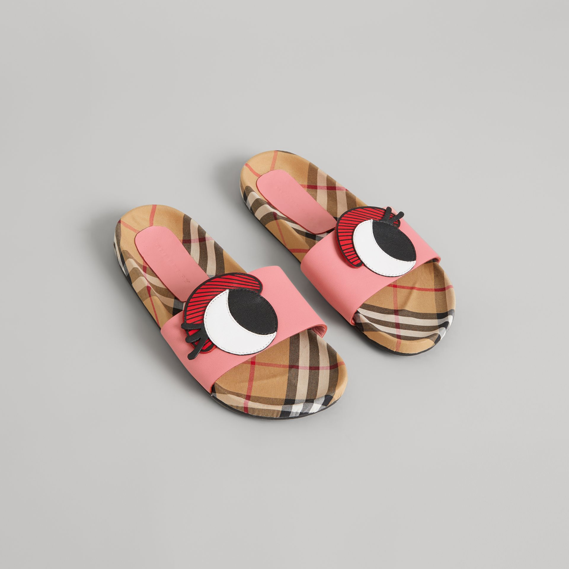 Eye Appliqué Vintage Check and Leather Slides in Pink Azalea | Burberry Canada - gallery image 0
