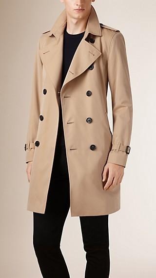 Trench-coat en gabardine de coton rembourré en duvet