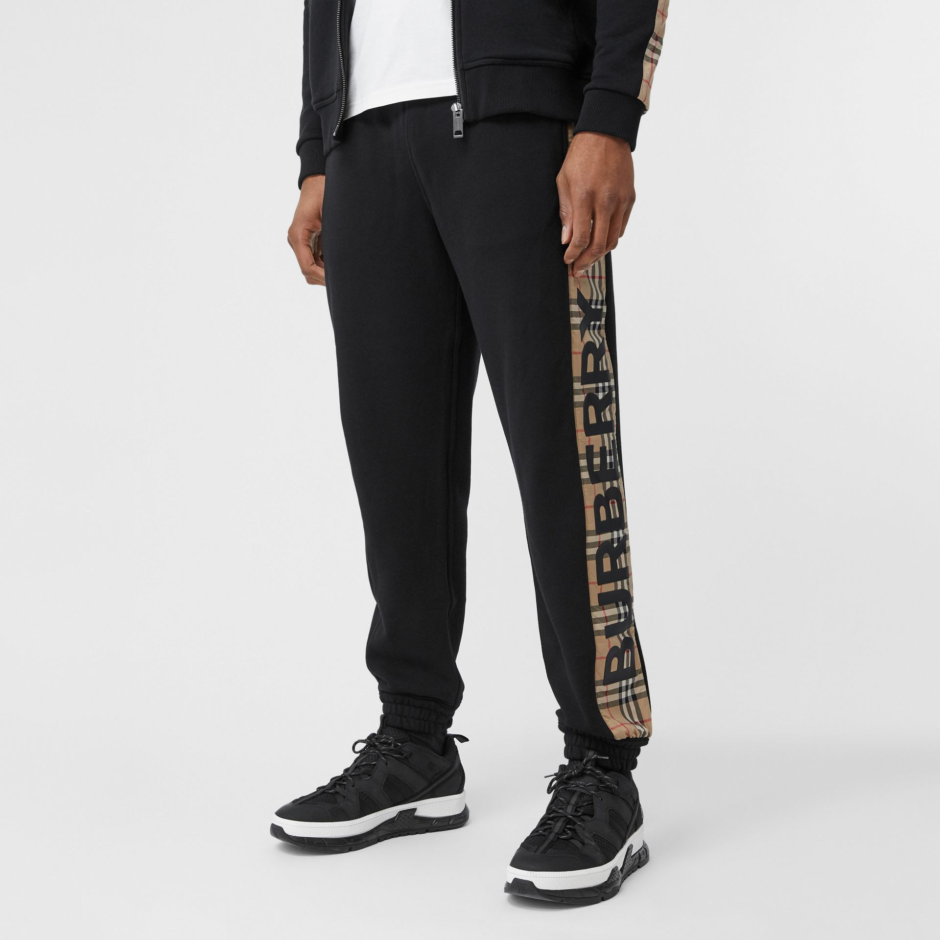 Logo Print Check Panel Cotton Trackpants in Black - Men | Burberry - gallery image 4