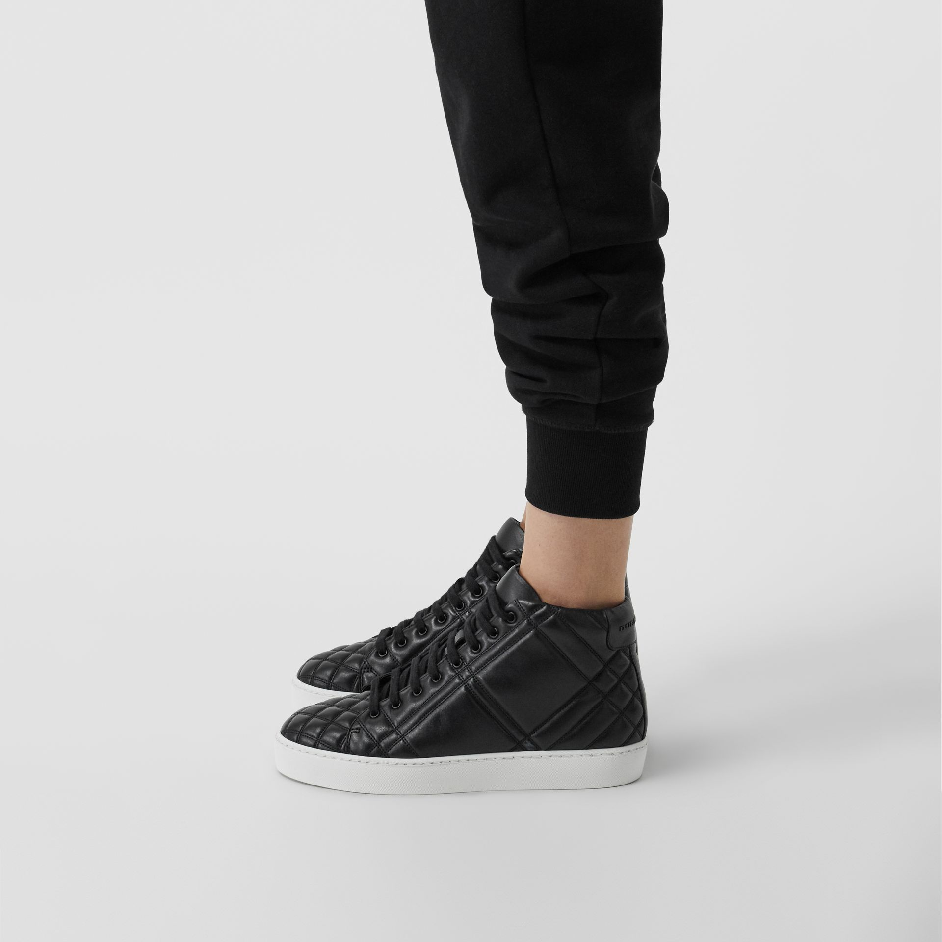 Check-quilted Leather High-top Sneakers in Black - Women | Burberry - gallery image 2