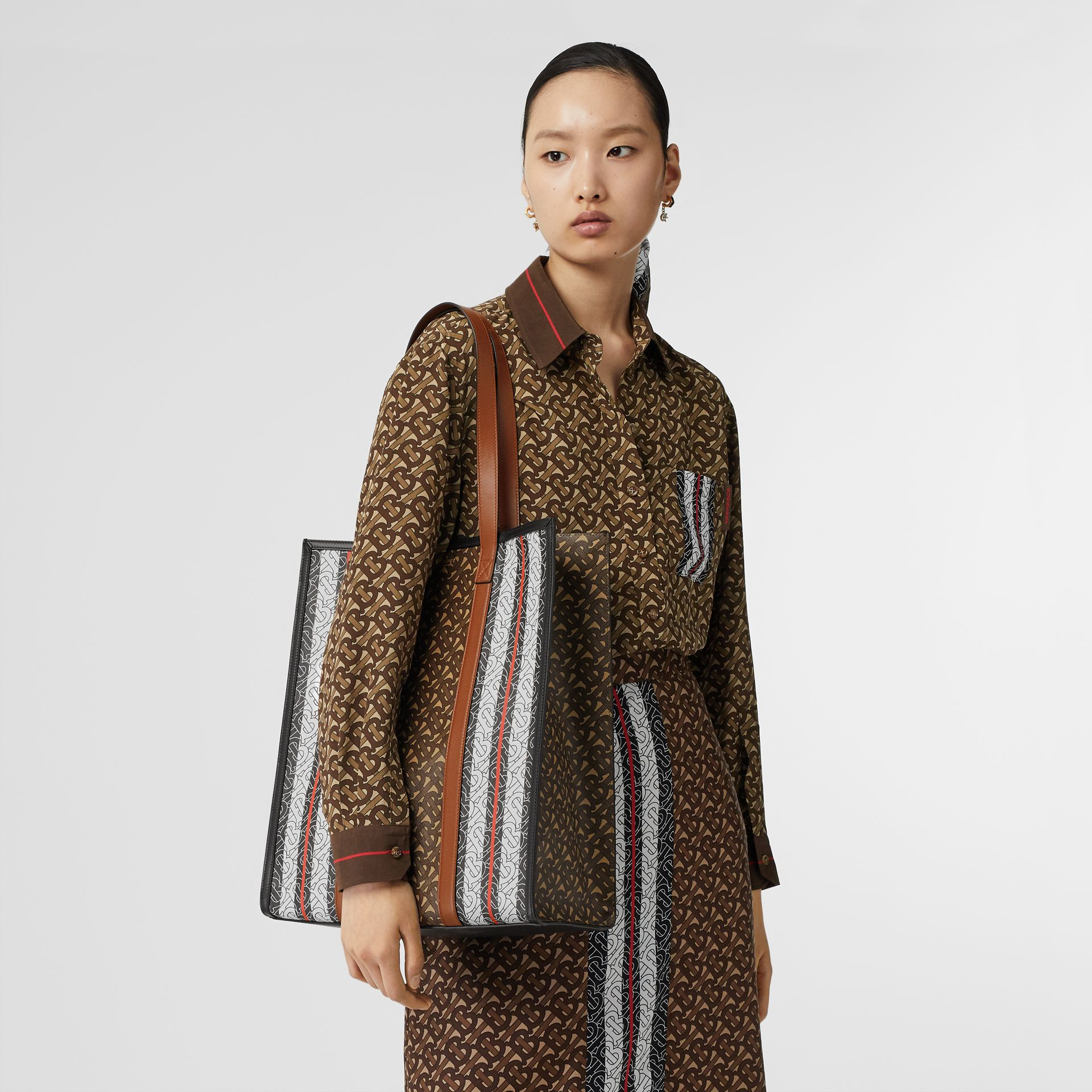 Monogram Stripe E-canvas Portrait Tote Bag in Bridle Brown | Burberry Singapore - gallery image 1