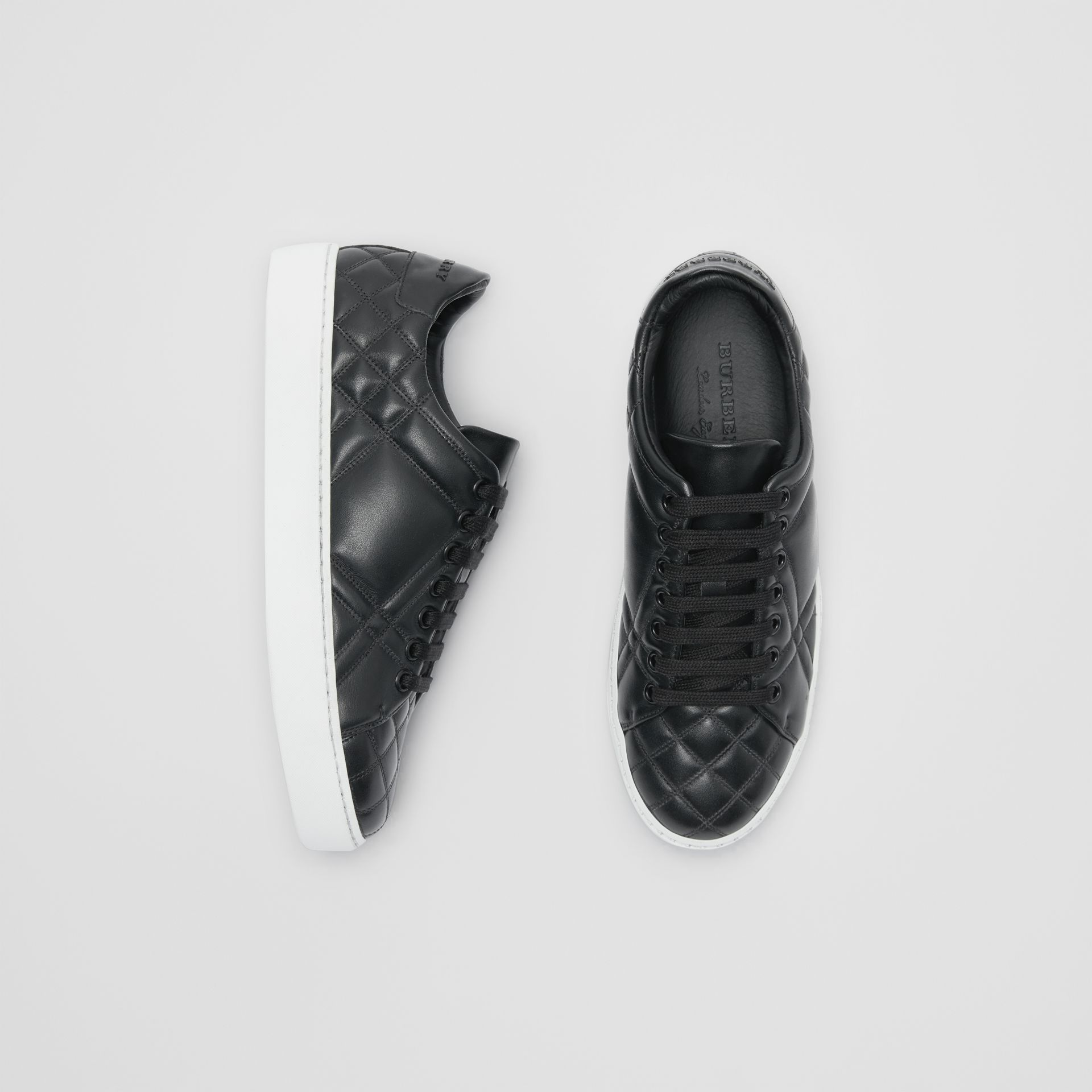 Check-quilted Leather Sneakers in Black - Women | Burberry - gallery image 0